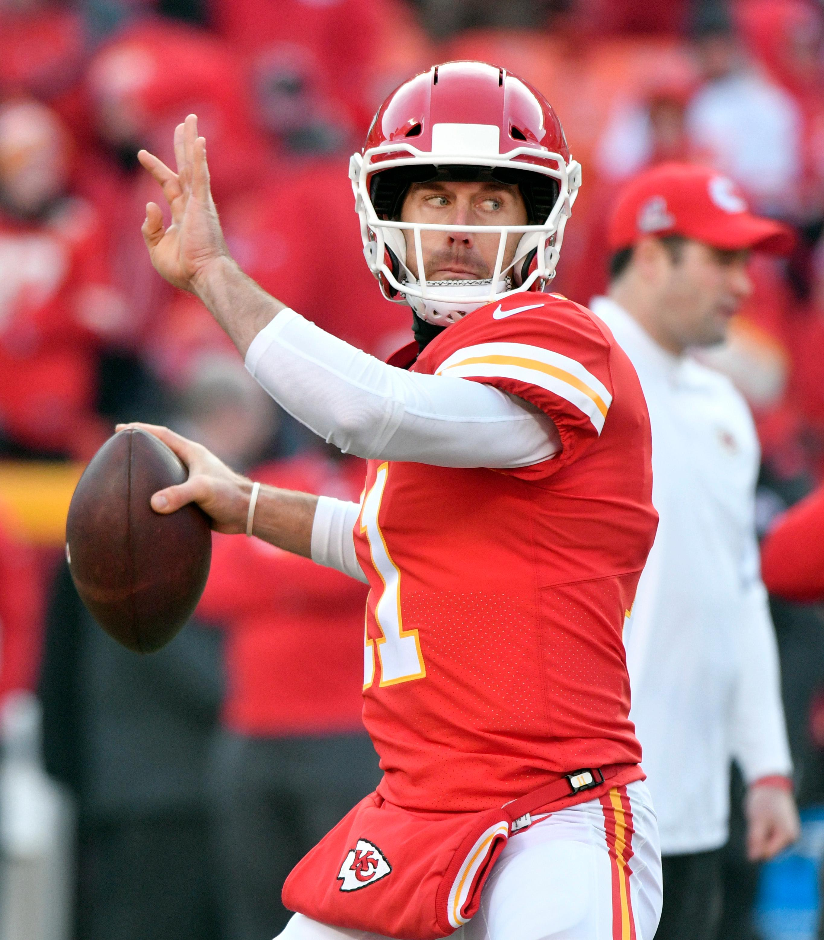 Kansas City Chiefs quarterback Alex Smith (11) warms up before an NFL wild-card playoff football game against the Tennessee Titans, in Kansas City, Mo., Saturday, Jan. 6, 2018. (AP Photo/Ed Zurga)