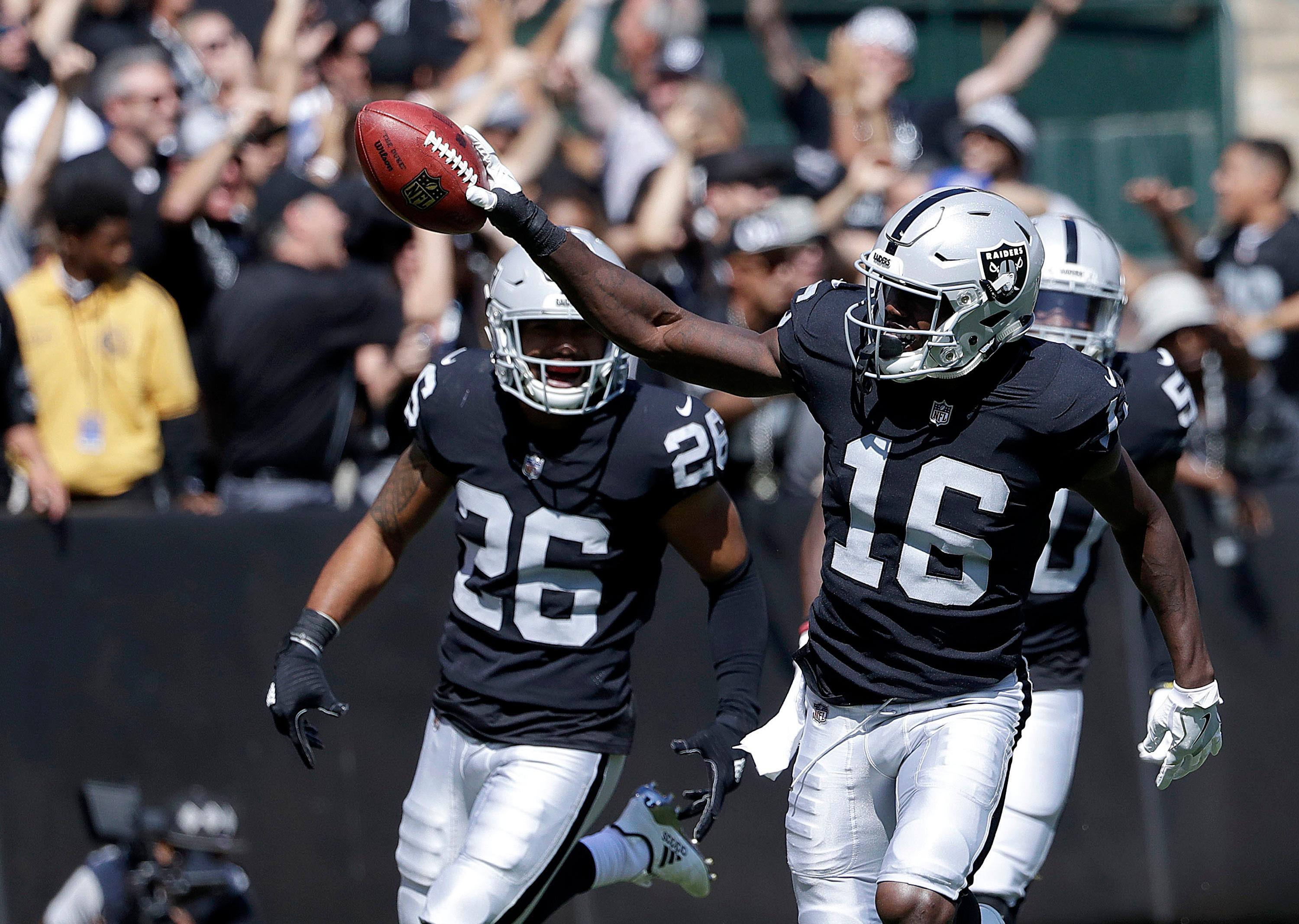 Oakland Raiders' Johnny Holton (16) celebrates after recovering a fumble by New York Jets' Kalif Raymond during the first half of an NFL football game in Oakland, Calif., Sunday, Sept. 17, 2017. (AP Photo/Marcio Jose Sanchez)