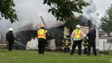 Fire crews respond to fully engulfed garage fire in Quincy