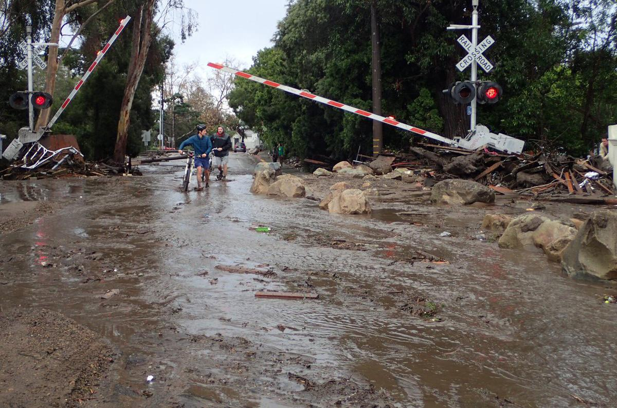 In this photo provided by Santa Barbara County Fire Department, the main line of the Union Pacific Railroad through Montecito, Calif, is blocked with mudflow and debris due to heavy rains on Tuesday, Jan. 9, 2018. Several homes were swept away before dawn Tuesday when mud and debris roared into neighborhoods in Montecito from hillsides stripped of vegetation during a recent wildfire. (Mike Eliason/Santa Barbara County Fire Department via AP)