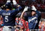 Milwaukee Brewers' Brett Phillips, right, is congratulated by teammate Jonathan Villar after hitting a three-run home run during the first inning against the St. Louis Cardinals, Sunday, Oct. 1, 2017, in St. Louis.