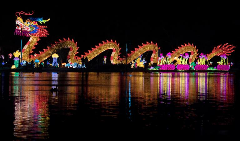 A large dragon is reflected in a pond on the opening night of the China Lights lantern festival Friday, January 19, 2018, at Craig Ranch Regional Park in North Las Vegas. The festival, which features nearly 50 silk and LED light displays comprised of over 1000 elements, runs through February 25th. CREDIT: Sam Morris/Las Vegas News Bureau
