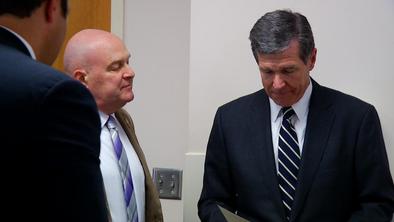 <p>Gov. Roy Cooper awarded the Order of the Long Leaf Pine to Western Carolina University Chancellor David Belcher. (Photo credit: WLOS staff)</p>