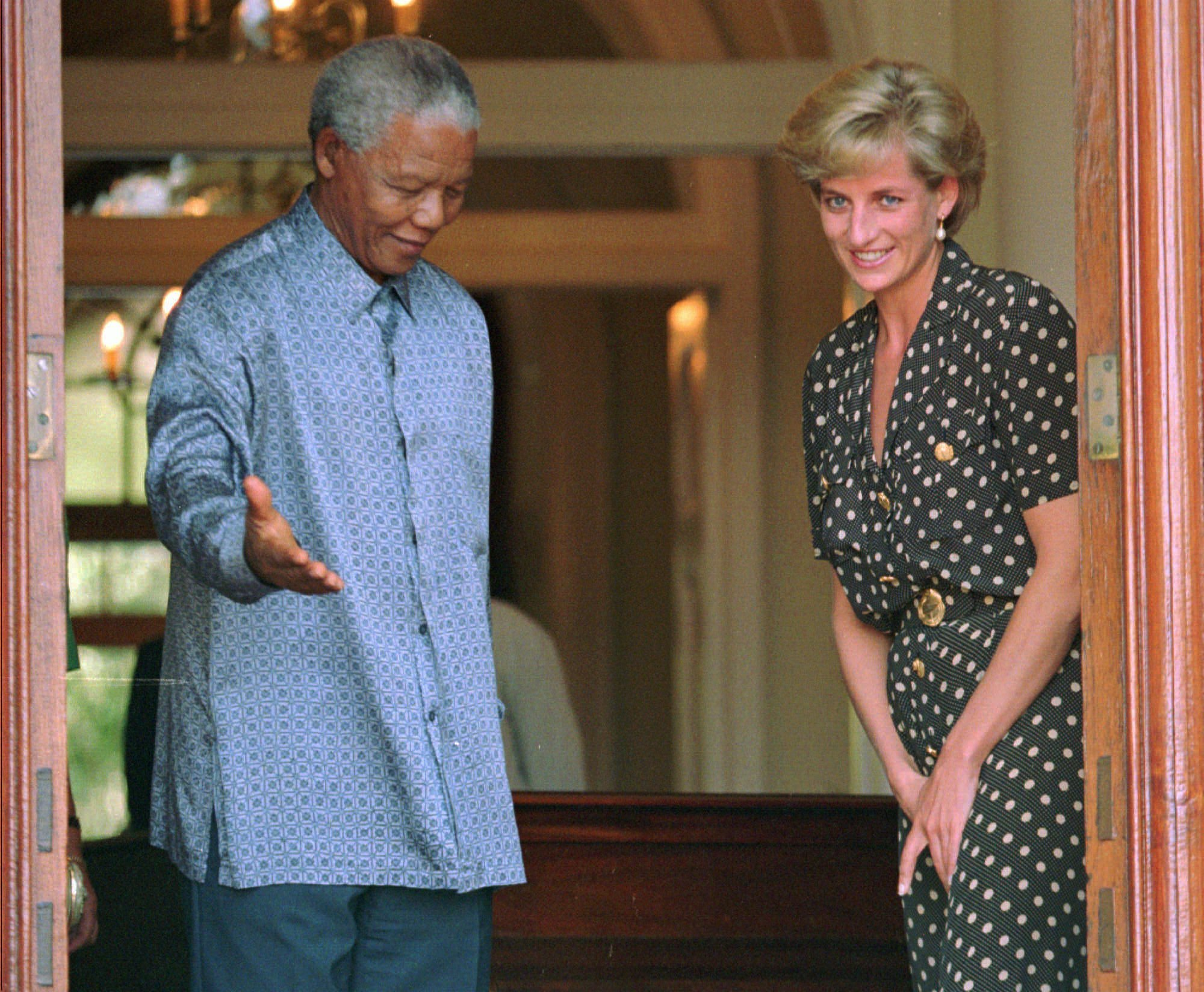 "FILE - In this Monday, March 17, 1997 file photo, South African President Nelson Mandela, left, shows the way to Princess Diana, during a meeting in Cape Town. It has been 20 years since the death of Princess Diana in a car crash in Paris and the outpouring of grief that followed the death of the ""people's princess."" (AP Photo/Sasa Kralj, File)"