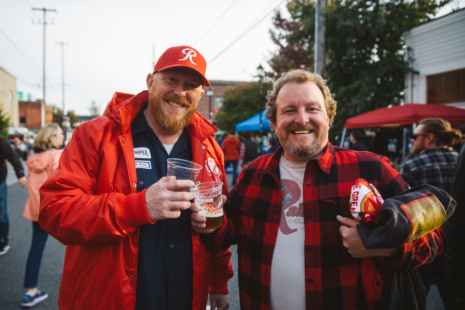 "Beer enthusiasts were treated to a free event in Georgetown to celebrate 'R Day', an annual celebration of Rainier Beer's rich heritage. The day is filled with community, music and awesome merchandise. Patron's donned clothes, hats, jackets, emblazoned with the iconic 'R', all the while sipping delicious brews, including a special, limited release ""R-Town Red Ale,"" in collaboration with Georgetown Brewing Company. { }(Image: Ryan McBoyle / Seattle Refined).{ }"