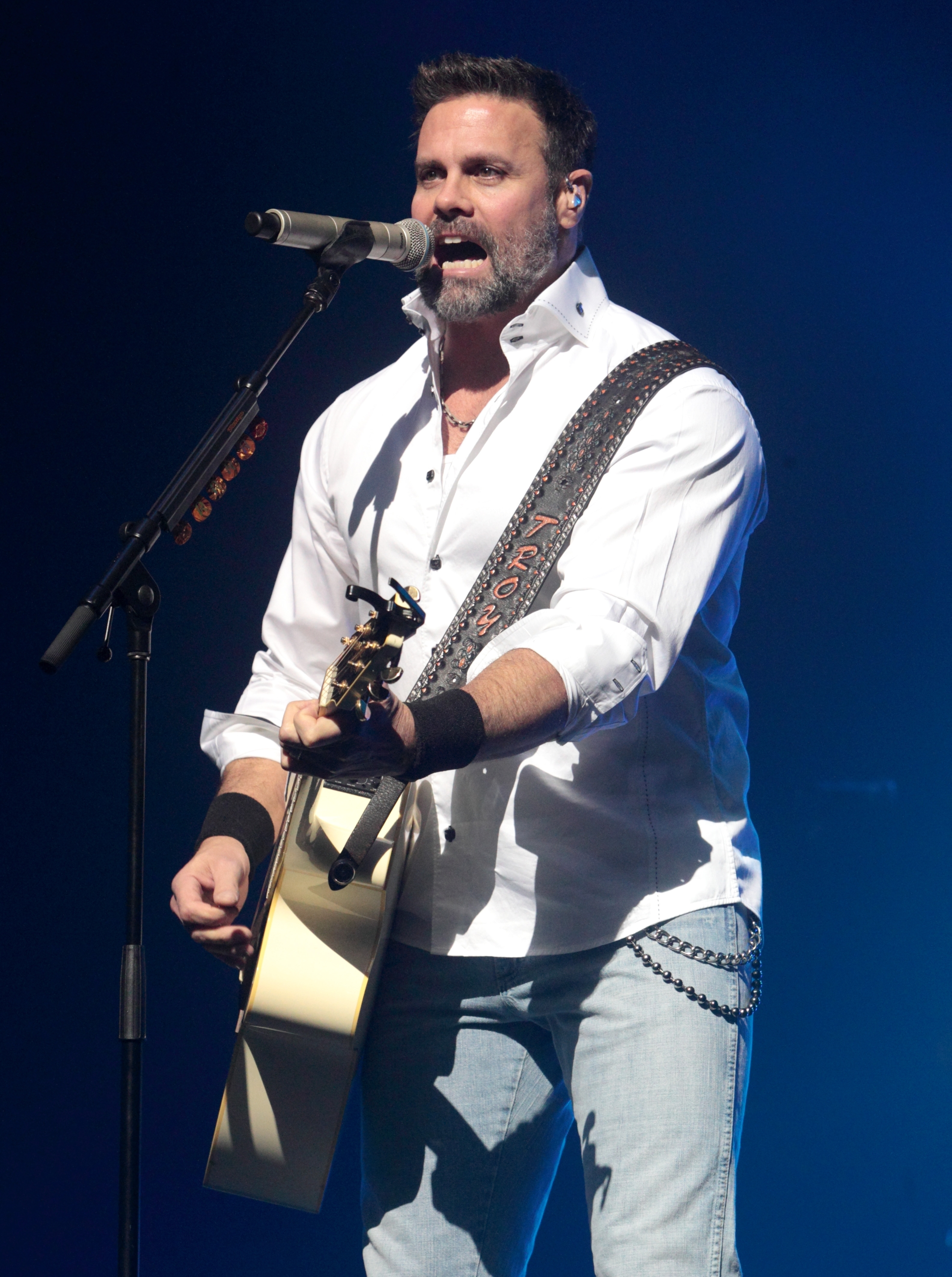 FILE -- In this Jan. 17, 2013, file photo, Troy Gentry of the Country Music duo Montgomery Gentry performs on the Rebels On The Run Tour in Lancaster, Pa. Gentry, one half of the award-winning country music duo Montgomery Gentry, died Friday, Sept. 8, 2017, in a helicopter crash, according to a statement from the band's website. (Photo by Owen Sweeney/Invision/AP, File)