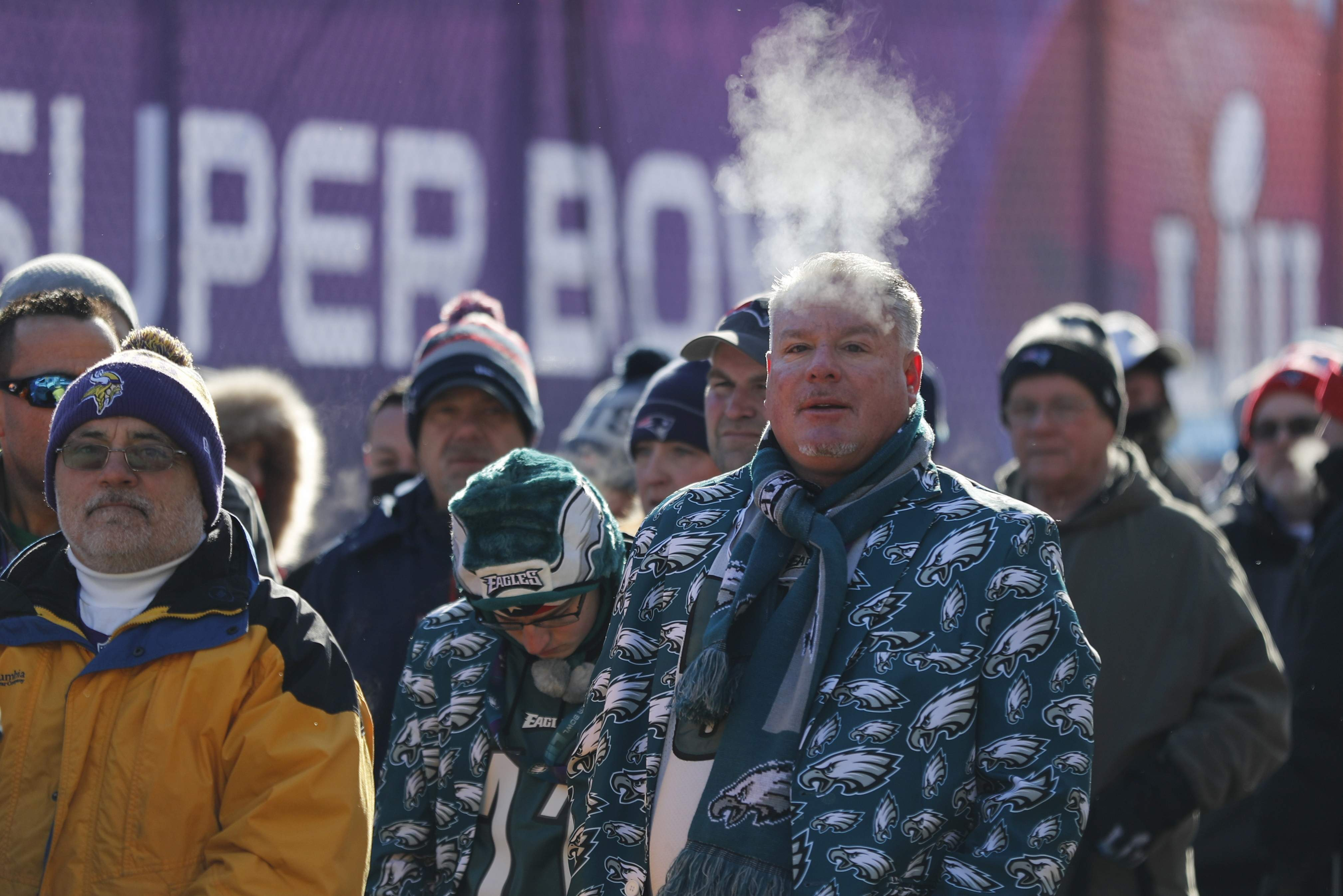 Fans brave cold temperatures as they wait to get into U.S. Bank Stadium before the NFL Super Bowl 52 football game between the Philadelphia Eagles and the New England Patriots Sunday, Feb. 4, 2018, in Minneapolis. (AP Photo/Jeff Roberson)