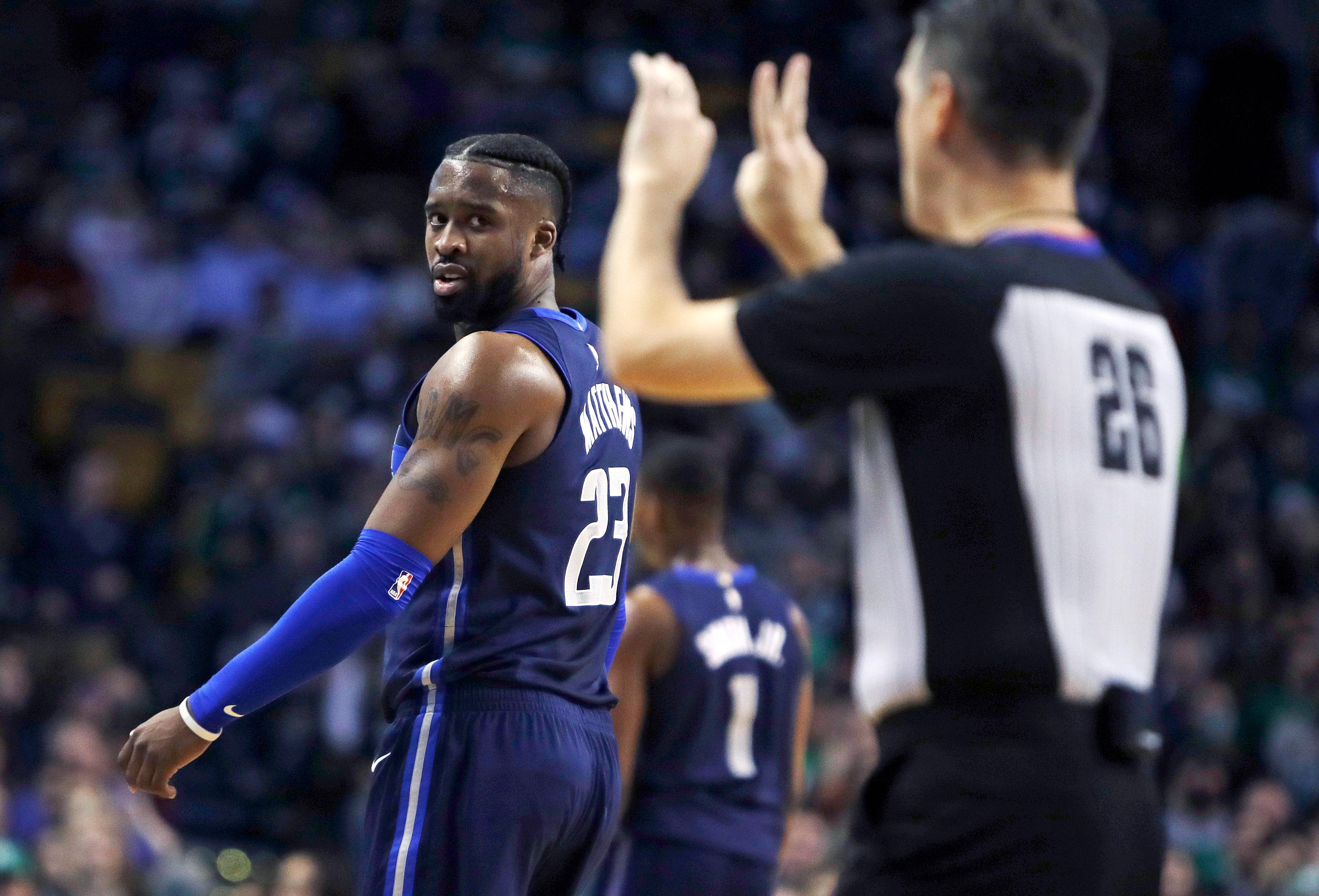 Dallas Mavericks guard Wesley Matthews looks back at referee Pat Fraher, right, as he is called for a personal and technical foul during the first quarter of an NBA basketball game against the Boston Celtics in Boston, Wednesday, Dec. 6, 2017. (AP Photo/Charles Krupa)