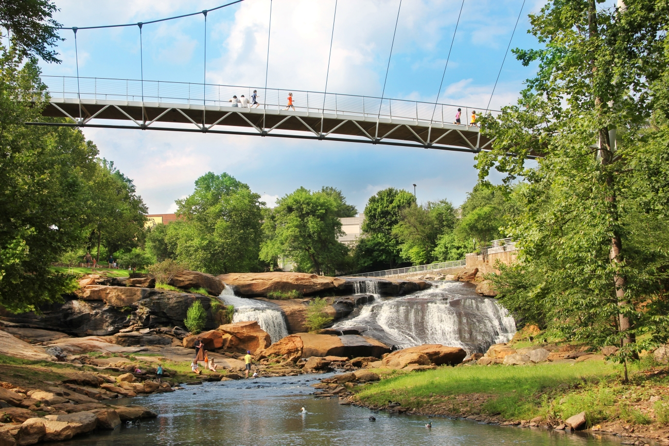 If you aren't afraid of heights, check out the one-of-a-kind Liberty Bridge at Falls Park on the Reedy. It's a pedestrian suspension bridge that offers killer views of a waterfall, public art, and gorgeous gardens. / Image courtesy of Visit Greenville // Published: 6.24.20