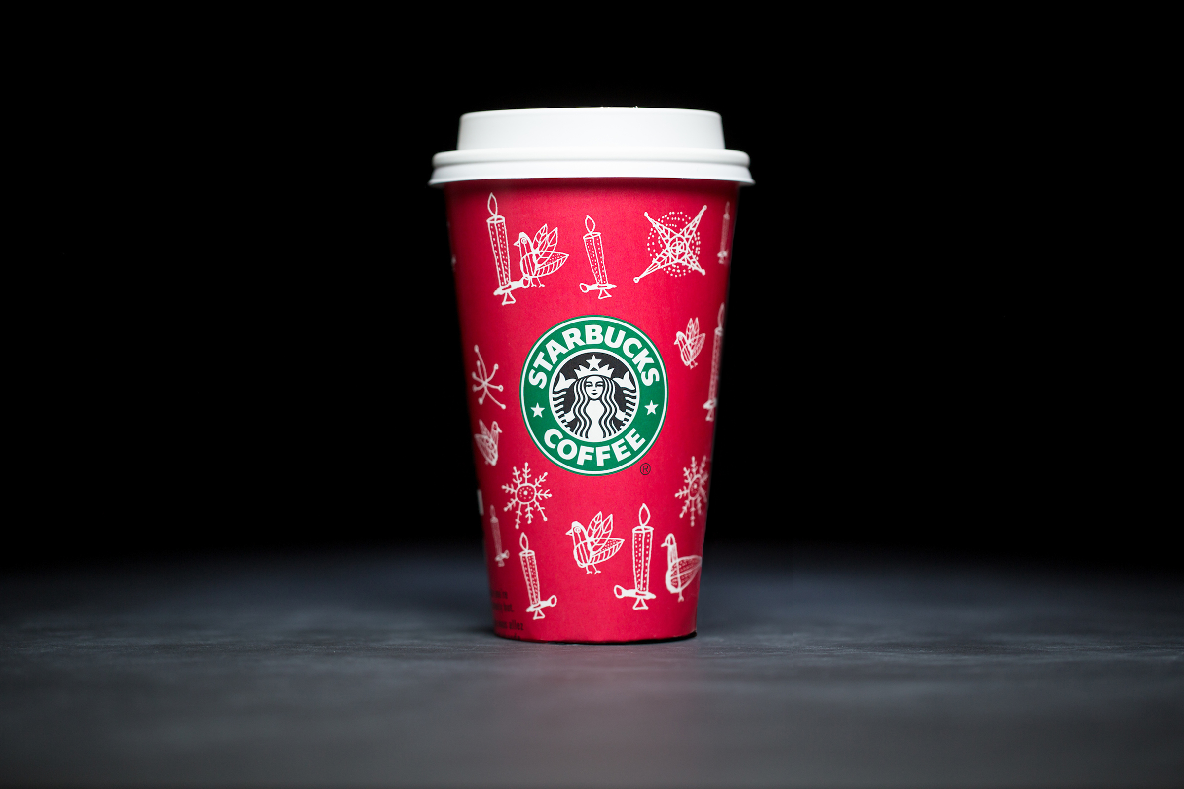 2002: For 20 years, Starbucks have released a range of holiday cup designs, most of them based around their world famous red cup. It's not easy to find the very first Starbucks holiday cups, which made their debut in stores in 1997. Few were saved, and electronic design files were lost in an earthquake in 2001. Even an Internet search is unyielding, with the cups having made their arrival long before the first selfie. But, we have them here! Click on for a photos of all 20 holidays cup designs. (Image: Joshua Trujillo/Cover Images)