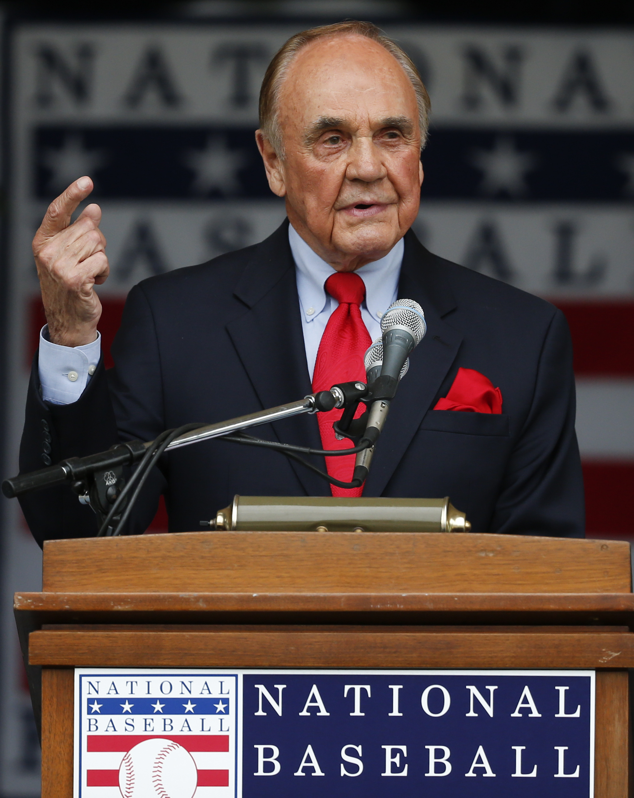 FILE - In this July 25, 2015, file photo, Dick Enberg speaks after receiving the Ford C. Frick Award during a ceremony at Doubleday Field in Cooperstown, N.Y. Enberg, the sportscaster who got his big break with UCLA basketball and went on to call Super Bowls, Olympics, Final Fours and Angels and Padres baseball games, died Thursday, Dec. 21, 2017. He was 82. Engberg's daughter, Nicole, confirmed the death to The Associated Press. She said the family became concerned when he didn't arrive on his flight to Boston on Thursday, and that he was found dead at his home in La Jolla, a San Diego neighborhood. (AP Photo/Mike Groll, File)