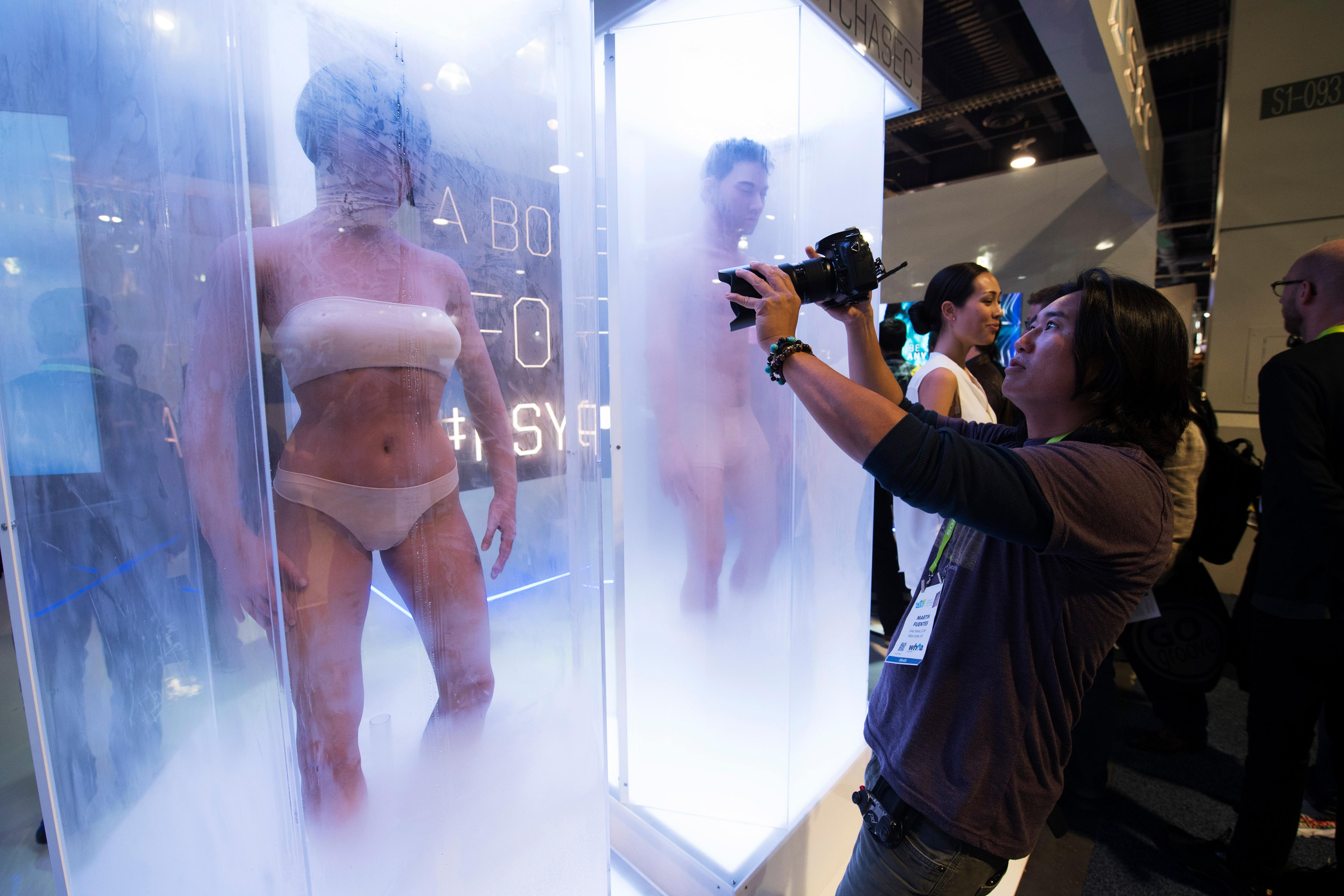 "Photographer Martin Fuentes photographs ""lab-grown body"" props from the upcoming Netflix series ""Altered Carbon"" during the second day of CES Wednesday, January 10, 2018, at the Las Vegas Convention Center. CREDIT: Sam Morris/Las Vegas News Bureau"
