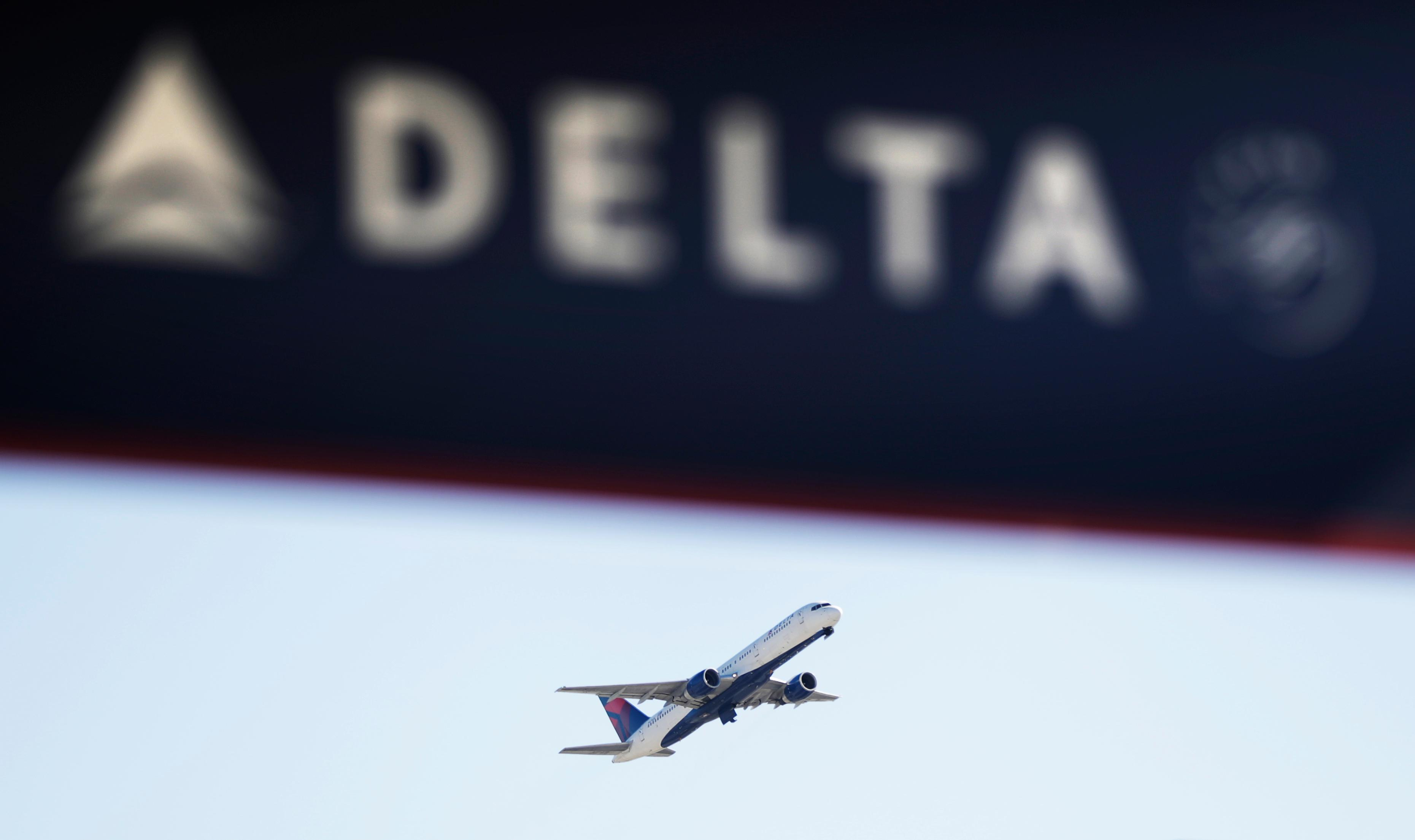 FILE - In this Jan. 30, 2017, file photo, a Delta Air Lines flight takes off from Hartsfield-Jackson Atlanta International Airport in Atlanta.{&amp;nbsp;} (AP Photo/David Goldman, File)<p></p>