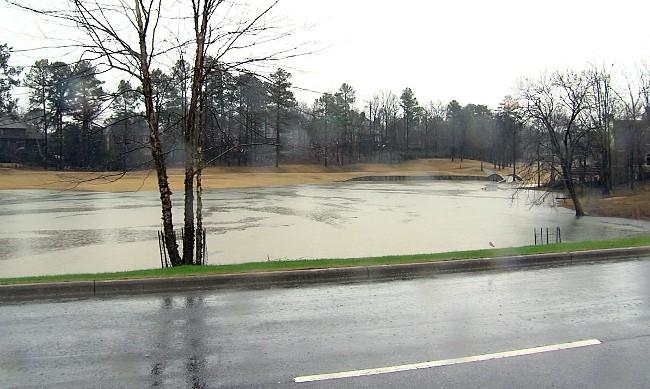 Heavy rains caused this pond in Greystone to overflow on Wednesday.