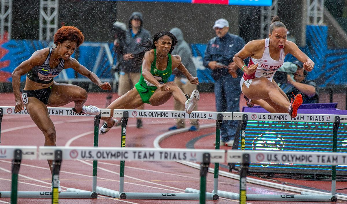 The rain was powerless at keeping Nike's Brianna Rollins hair down on Friday, as she stormed to victory in both the semi-finals and finals with a time of 12.34. Photo by August Frank, Oregon News Lab