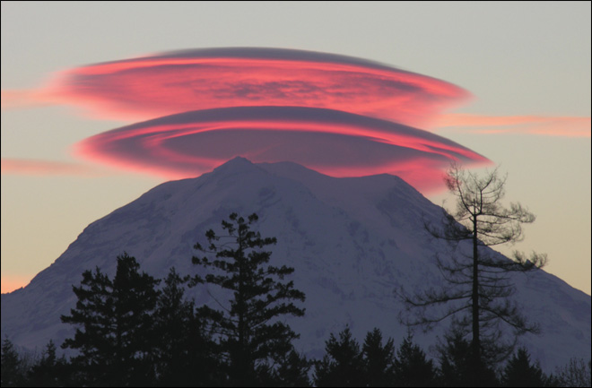 A double-stacked lenticular cloud appears at sunrise over Mt. Rainier on Nov. 20, 2004 (Photo: Jim George, Puyallup, WA)