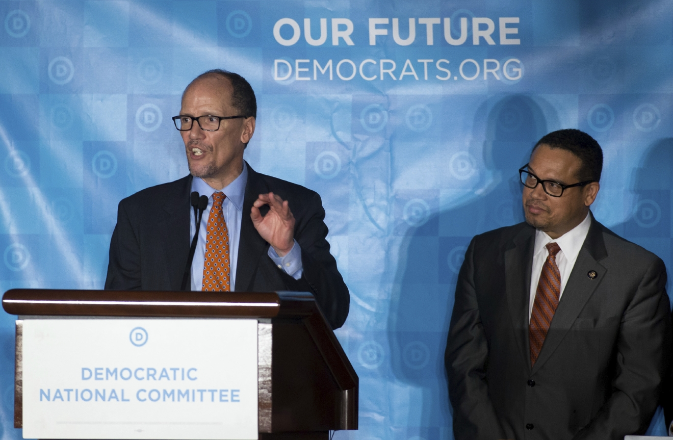 Newly elected Democratic National Committee Chairman Tom Perez, left, delivers his victory speech as Rep. Keith Ellison, D-Minn, listens during the general session of the DNC winter meeting in Atlanta, Saturday, Feb. 25, 2017. Perez picked runner-up Ellison to be deputy chairman. (AP Photo/Branden Camp)