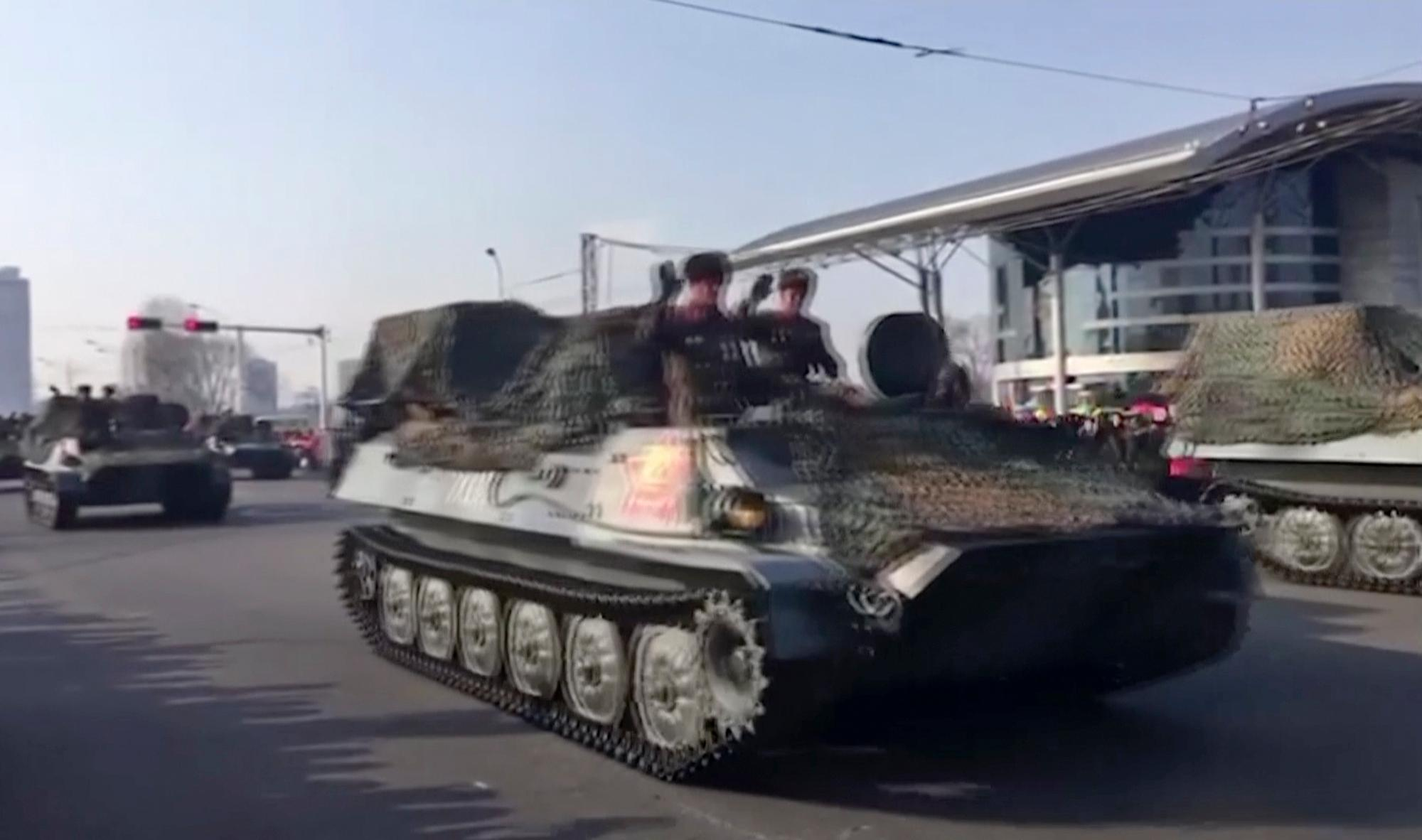 This image taken from video footage provided by Paektu Cultural Exchange shows military vehicles through streets in Pyongyang, North Korea, Thursday, Feb. 8, 2018. North Korea held a military parade and rally on Kim Il Sung Square on Thursday, just one day before South Korea holds the opening ceremony for the Pyeongchang Winter Olympics. (AP Photo)