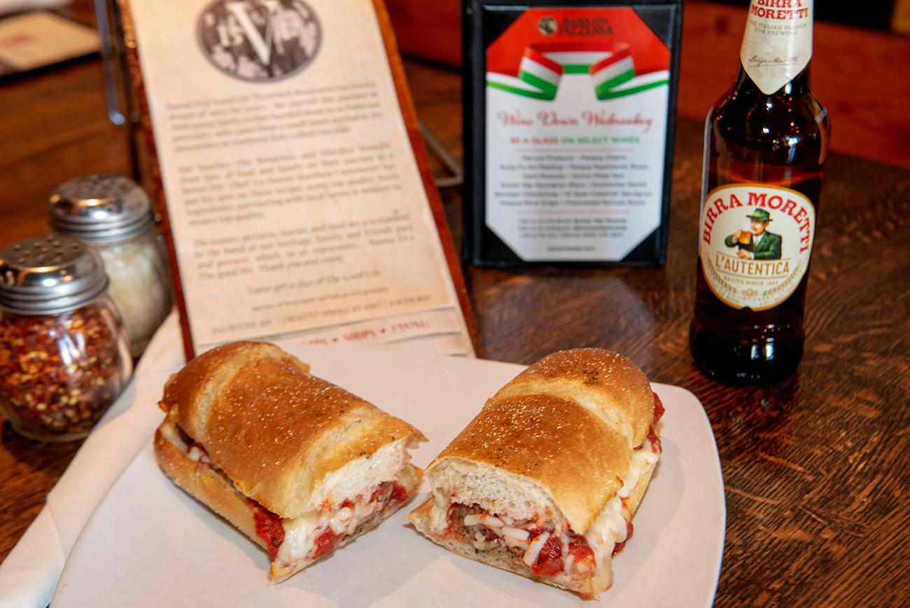 The meatball sub: Italian beef, homemade sauce, onions, and mozzarella cheese served with a bottle of Birra Moretti beer{ }/ Image: Joe Simon // Published: 3.10.19