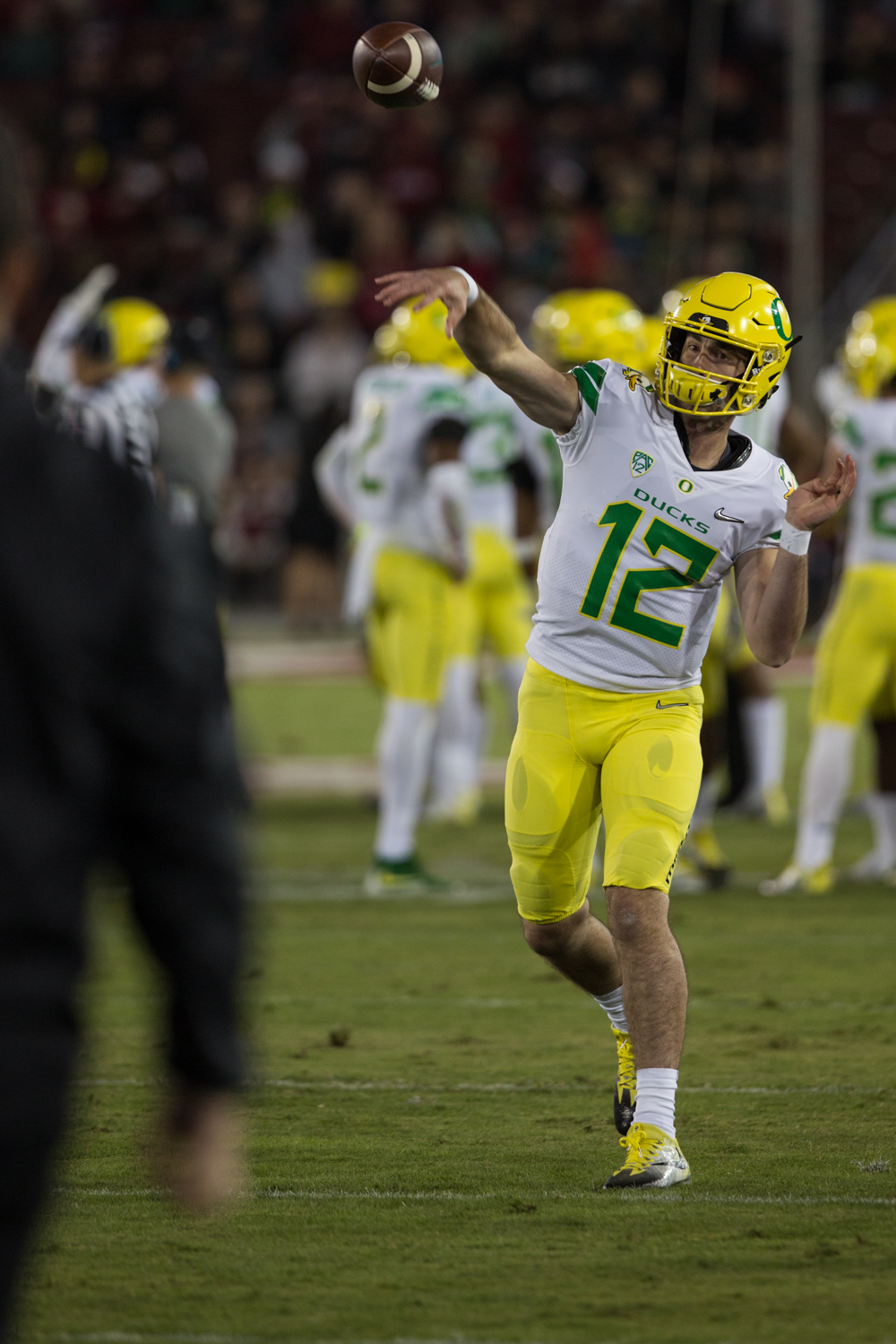 Oregon quarterback Taylor Alie (#12) warms up during the second half.  Oregon made a change at quarterback after a slow first quarter. The Oregon Ducks fell to the Stanford Cardinal 49-7 at Stanford Stadium, bringing their record to 4-3 for the season.  Photo by Austin Hicks, Oregon News Lab