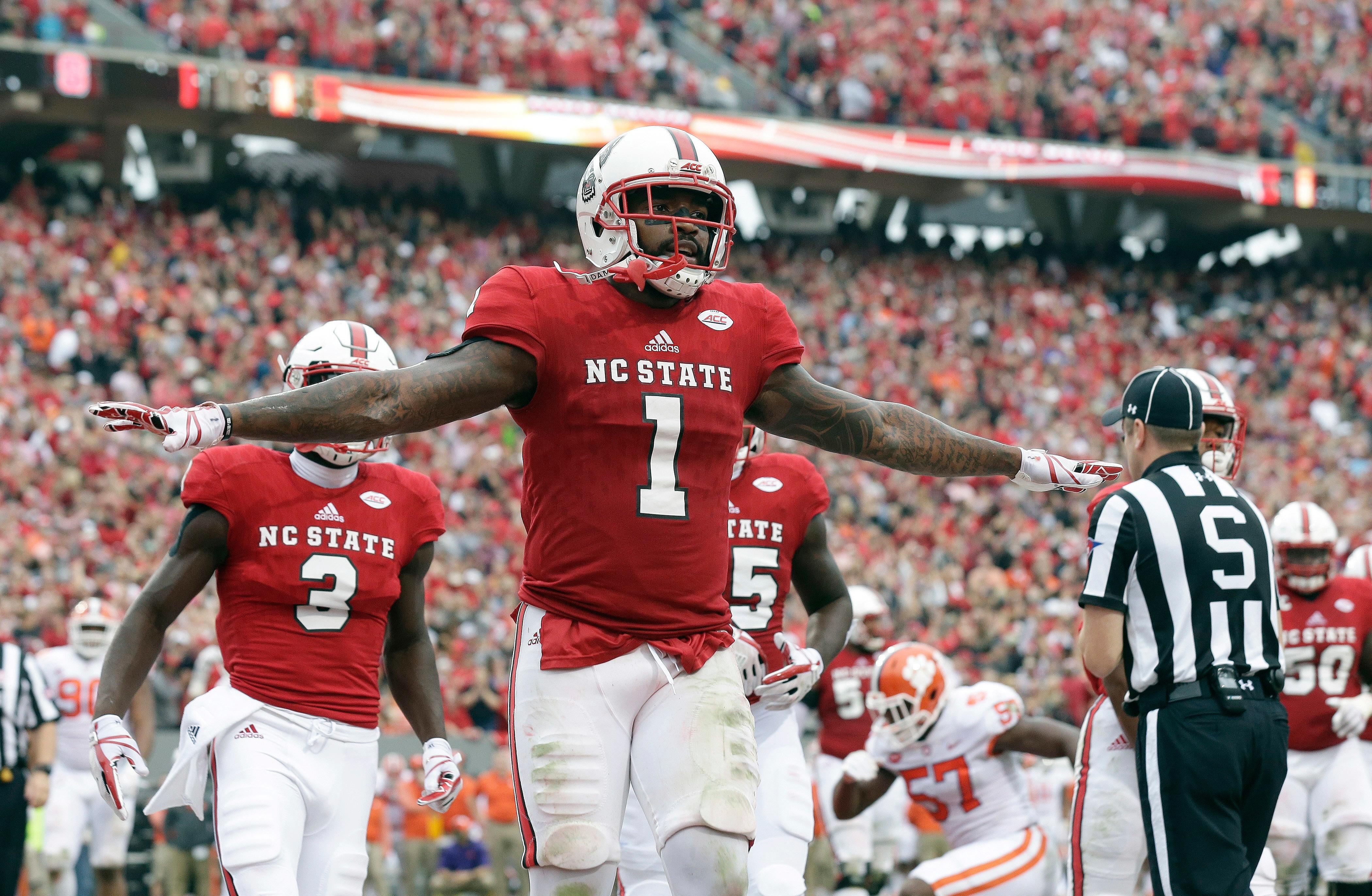 FILE - The Wolfpack (8-4) is seeking the second-most wins in school history, and trying to stay in the final College Football Playoff rankings. N.C. State was No. 24 going into bowl season.(AP Photo/Gerry Broome)