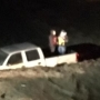 Firefighters rescue two people trapped in flood waters