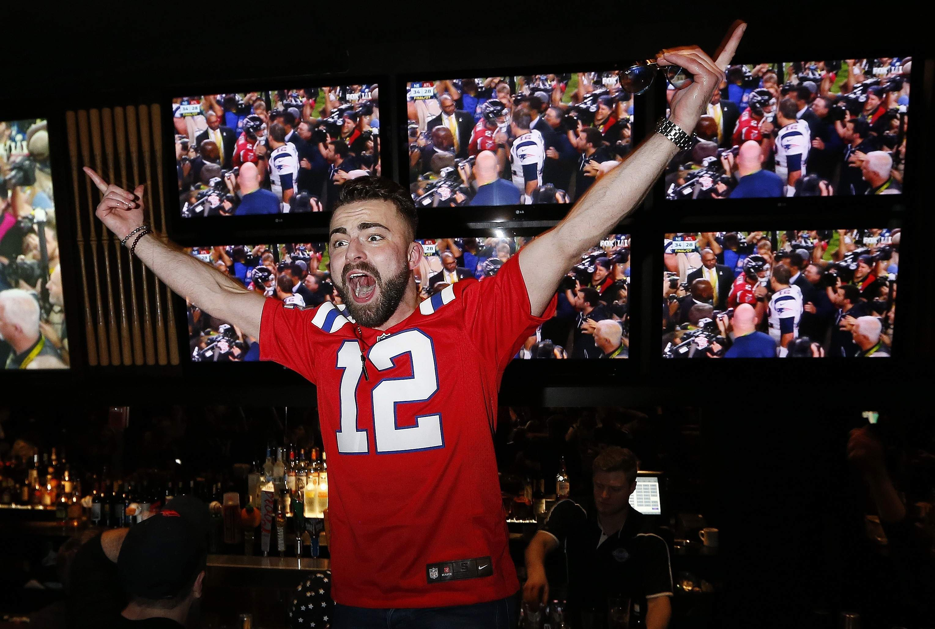 Brandon Washburn celebrates at a Boston bar after the New England Patriots defeated the Atlanta Falcons in Super Bowl 51 in Houston, Sunday, Feb. 5, 2017. The Patriots won 34-28. THE ASSOCIATED PRESS