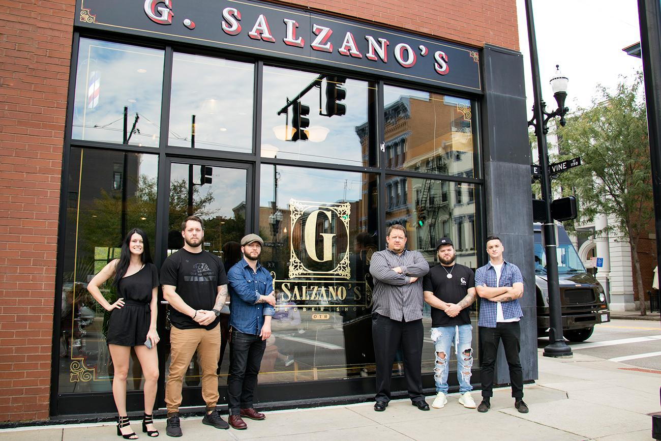 Guido Salzano, owner (pictured center) with his barbers{ }Mark Doyle, Aaron Mucha, Craigen Cavender, Sam Souders, and Felix Sepulveda (not pictured)  / Image: Allison McAdams // Published: 9.27.18