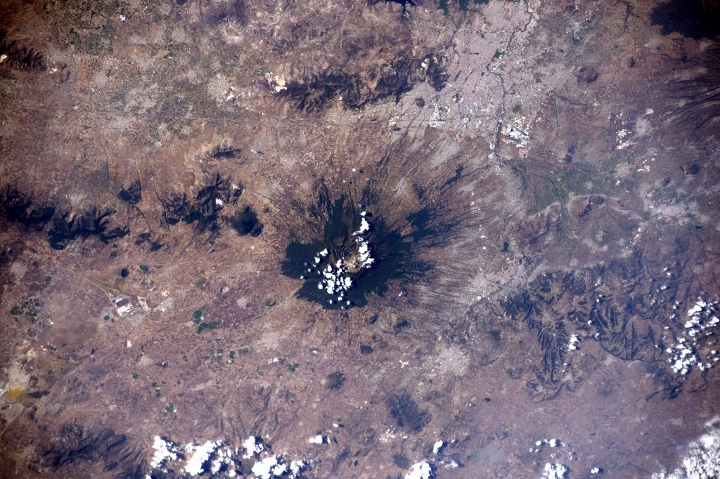 The inhabitants of Huamantla seem comfortable living that close to the Malinche volcano in Mexico (Photo & Caption: Thomas Pesquet // NASA)