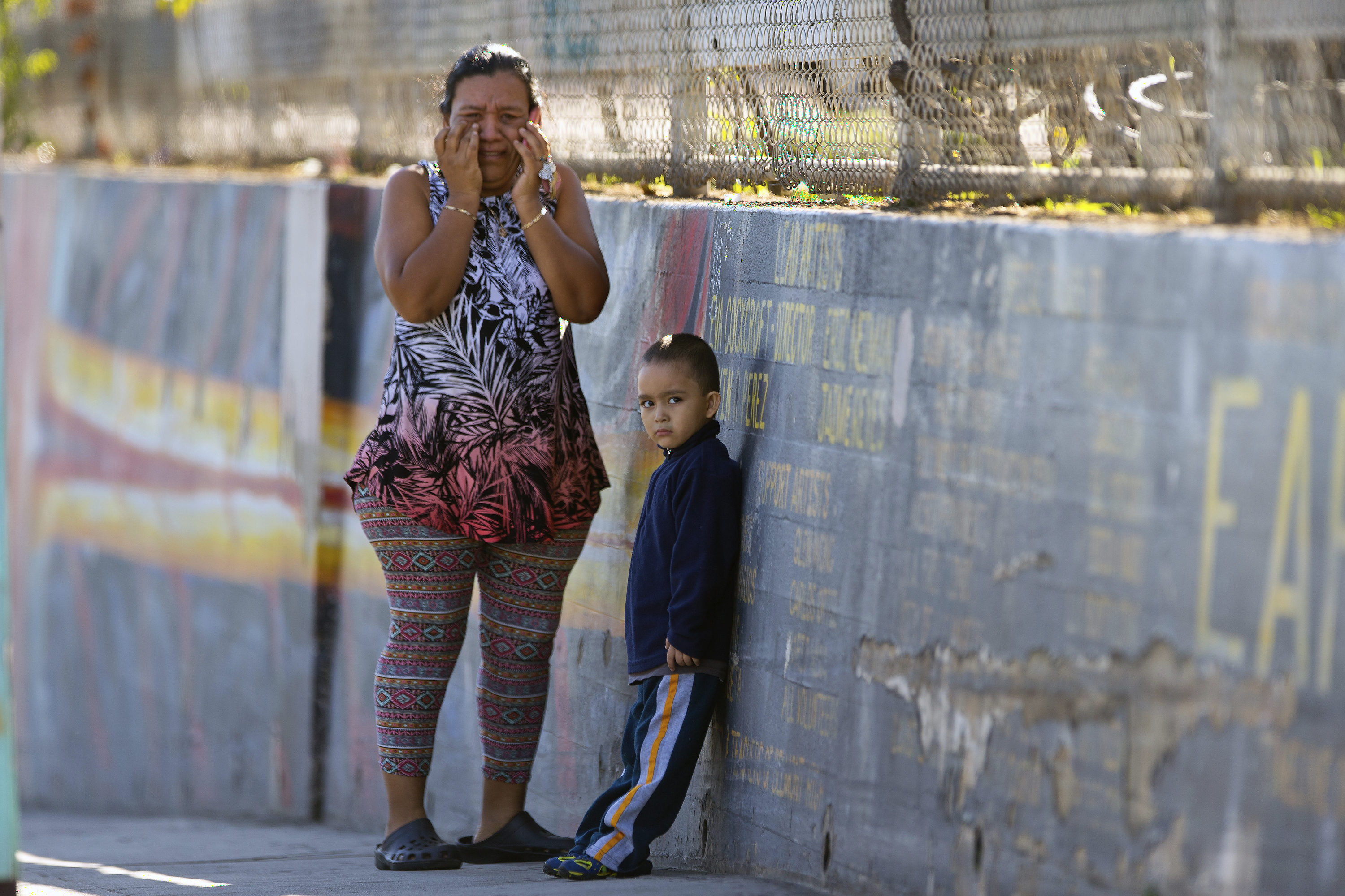 Mother Elizabeth Acevedo and her son Andres, 3, wait for news of her son Jose an eight-grader student at the Belmont High School in Los Angeles Thursday, Feb. 1, 2018. Two students were shot and wounded, one critically, inside a Los Angeles middle school classroom Thursday morning and police arrested a female student suspect, authorities said. (Damian Dovarganes)