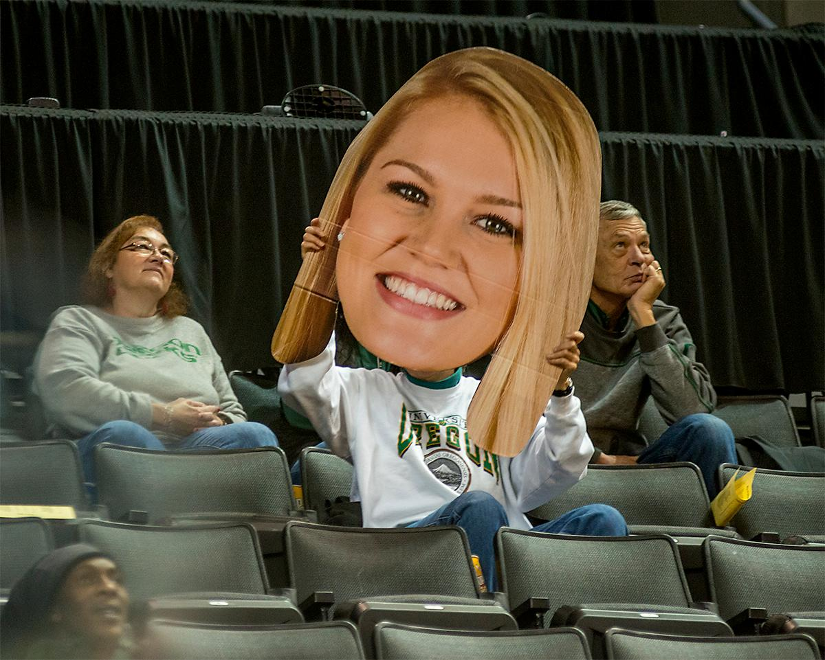 A fan in the stands holds up a cardboard cutout of a Ducks player. The UO Ducks Women's basketball team took the win against Idaho on Tuesday at Matthew Knight Arena, 73-70, in a game that saw the Ducks force a miss at the buzzer. Maite Cazorla (#5) achieved a double-double with 14 points and 10 assists. Lexi Bando (#10) added 17 points, and made 5 out of 6 three pointers. The Ducks are now 10-2 this season. Photos by August Frank, Oregon News Lab