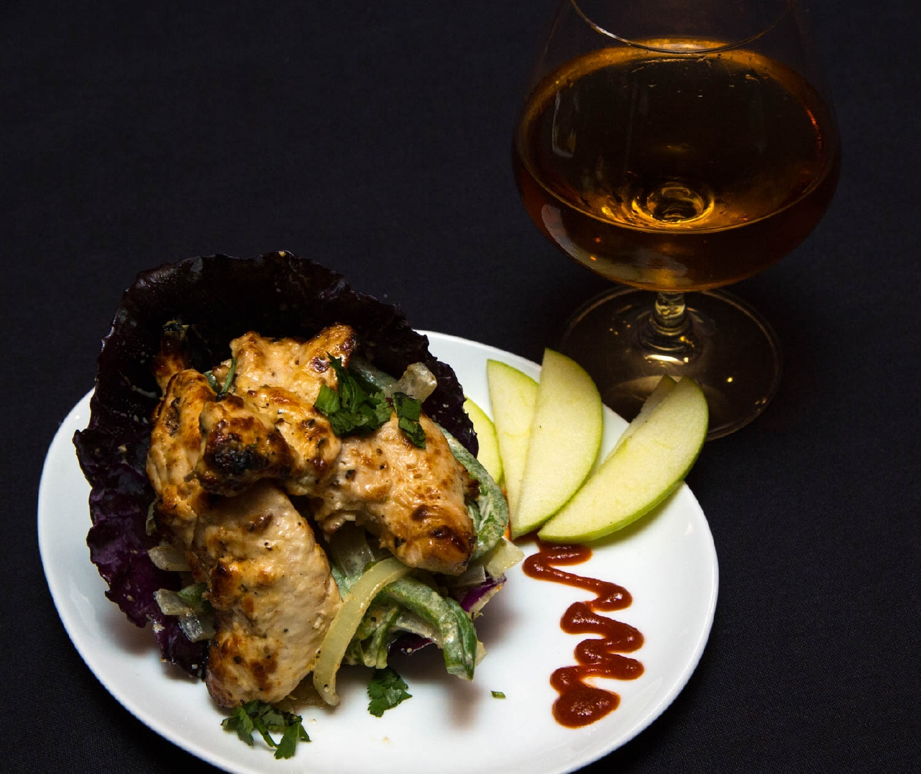 Chicken of Afghani served with caramelized onion and peppers  and a glass of neat scotch. / Image: Catherine Viox / Published: 11.4.16