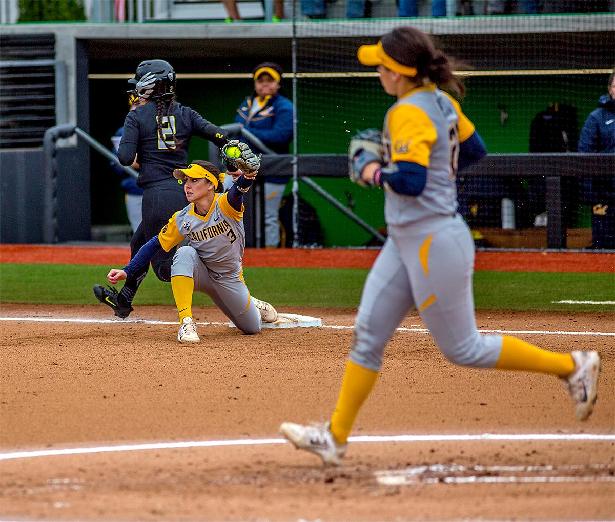 The Duck's Danica Mercado edges her way to a safe on first base. The Oregon Ducks defeated the Cal Golden Bears 2-1 in the second game of the three game series. Photo by August Frank, Oregon News Lab