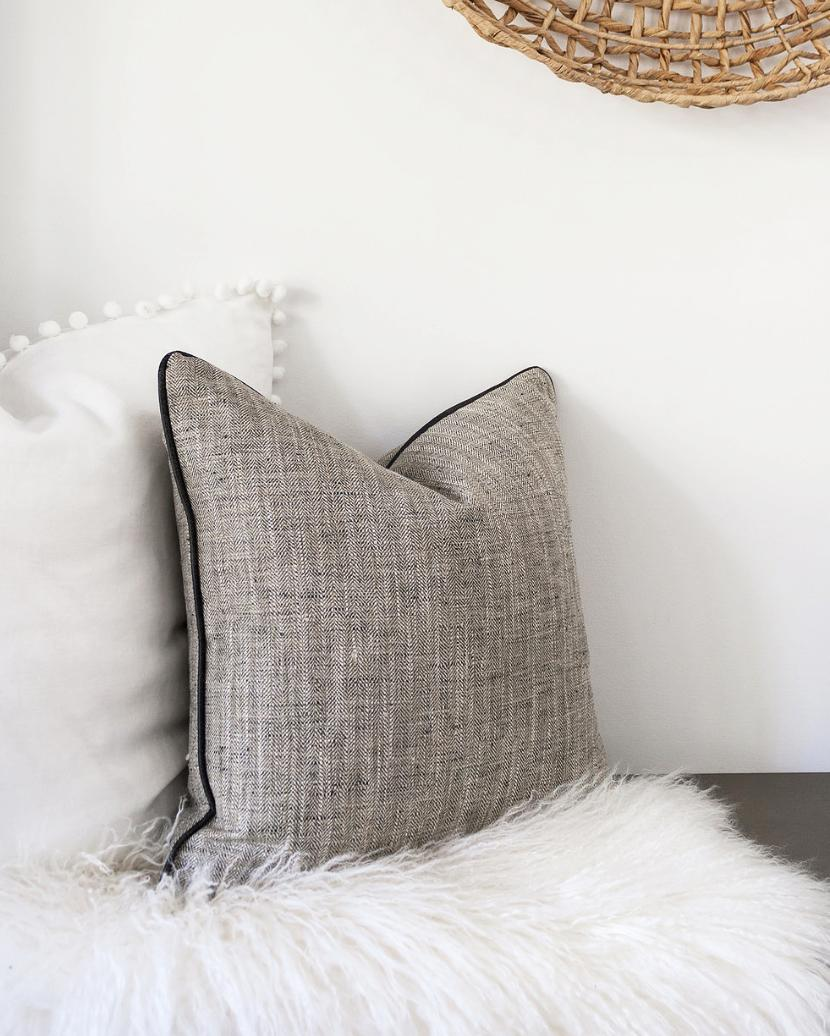 Tweed is a pattern that never really seems to go out of style and throw pillows are a great way to freshen a room up without breaking the bank.  You can also rotate them seasonally. https://bit.ly/2PP53RI (Image: Ashley Hafstead)