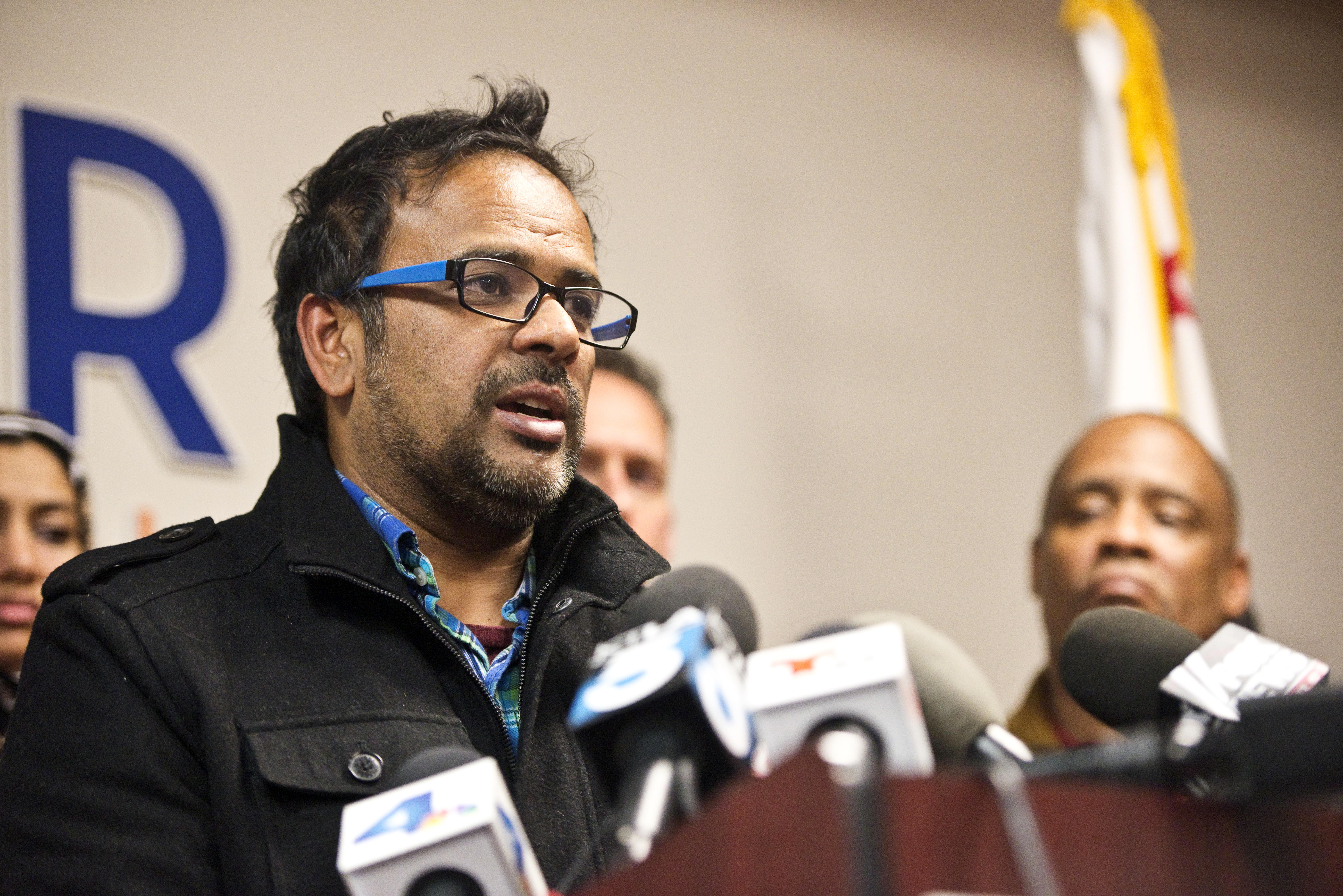 Farhan Khan, brother-in-law of one of the suspects involved in a shooting in San Bernardino, Calif., speaks during a news conference at the Greater Los Angeles Area office of the Council on American-Islamic Relations, in Anaheim, Calif. Multiple attackers opened fire on a banquet at a social services center for the disabled in San Bernardino on Wednesday, killing multiple people and sending police on a manhunt for suspects. (Matt Masin/The Orange County Register via AP)