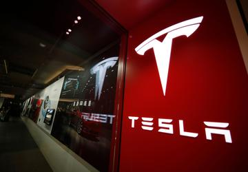 Tesla's stock soars after company posts surprising 3Q profit