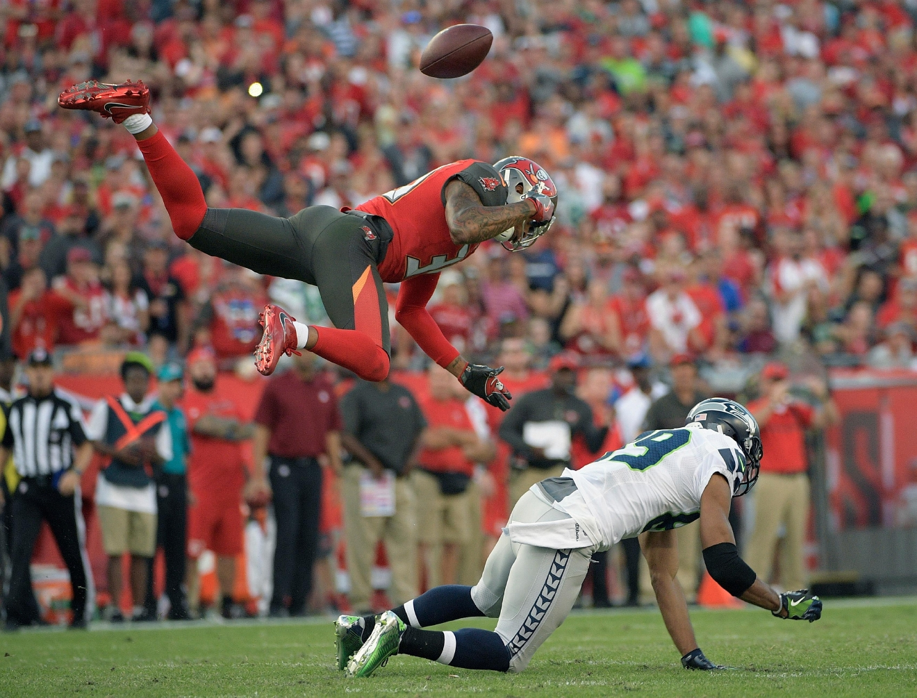 Seattle Seahawks wide receiver Doug Baldwin (89) loses the football as he is hit by Tampa Bay Buccaneers free safety Bradley McDougald (30) during the second quarter of an NFL football game Sunday, Nov. 27, 2016, in Tampa, Fla. McDougald was called for a pass interference penalty. (AP Photo/Phelan Ebenhack)