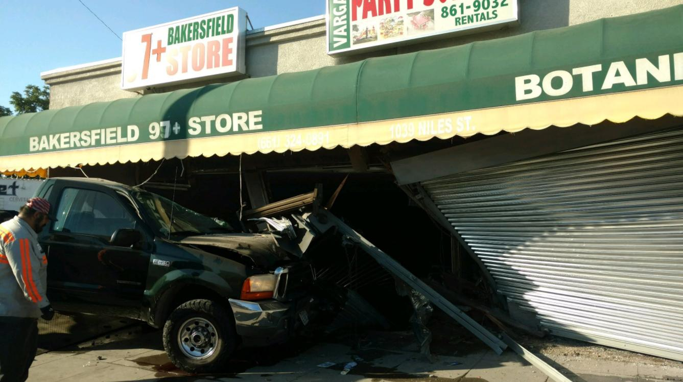A truck is seen after crashing into a pair of businesses Thursday morning, June 15, 2017 at Niles and Gage streets in Bakersfield, Calif. (KBAK/KBFX photo/Claudette Stefanian)