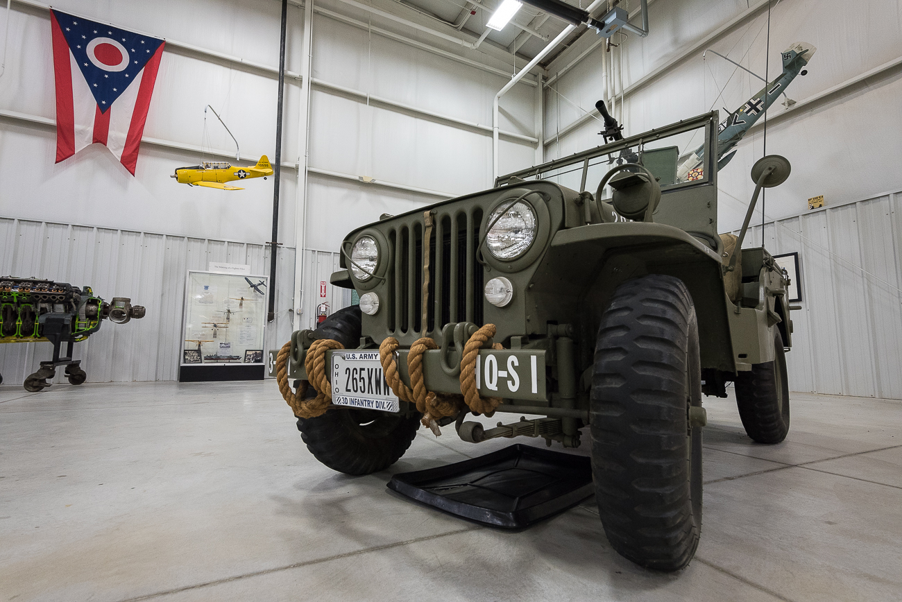 Not only does the Tri-State Warbird Museum have old planes from the WWII era, it also keeps vintage automobiles and jeeps in its hangars. / Image: Phil Armstrong, Cincinnati Refined // Published: 9.6.17