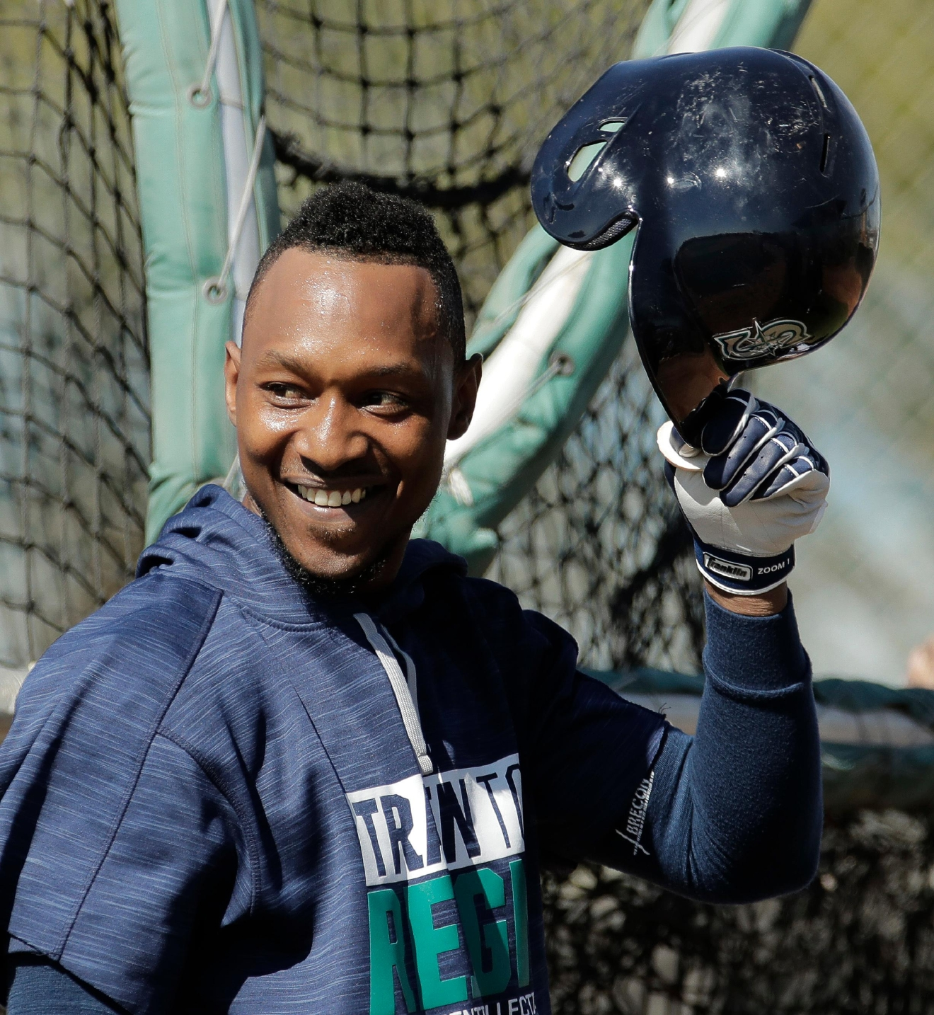 Seattle Mariners' Jarrod Dyson watches batting practice during baseball spring training Tuesday, Feb. 21, 2017, in Peoria, Ariz. (AP Photo/Charlie Riedel)