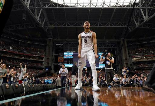 Gonzaga's Nigel Williams-Goss (5) celebrates after the semifinals of the Final Four NCAA college basketball tournament against South Carolina, Saturday, April 1, 2017, in Glendale, Ariz. Gonzaga won 77-73. (AP Photo/David J. Phillip)