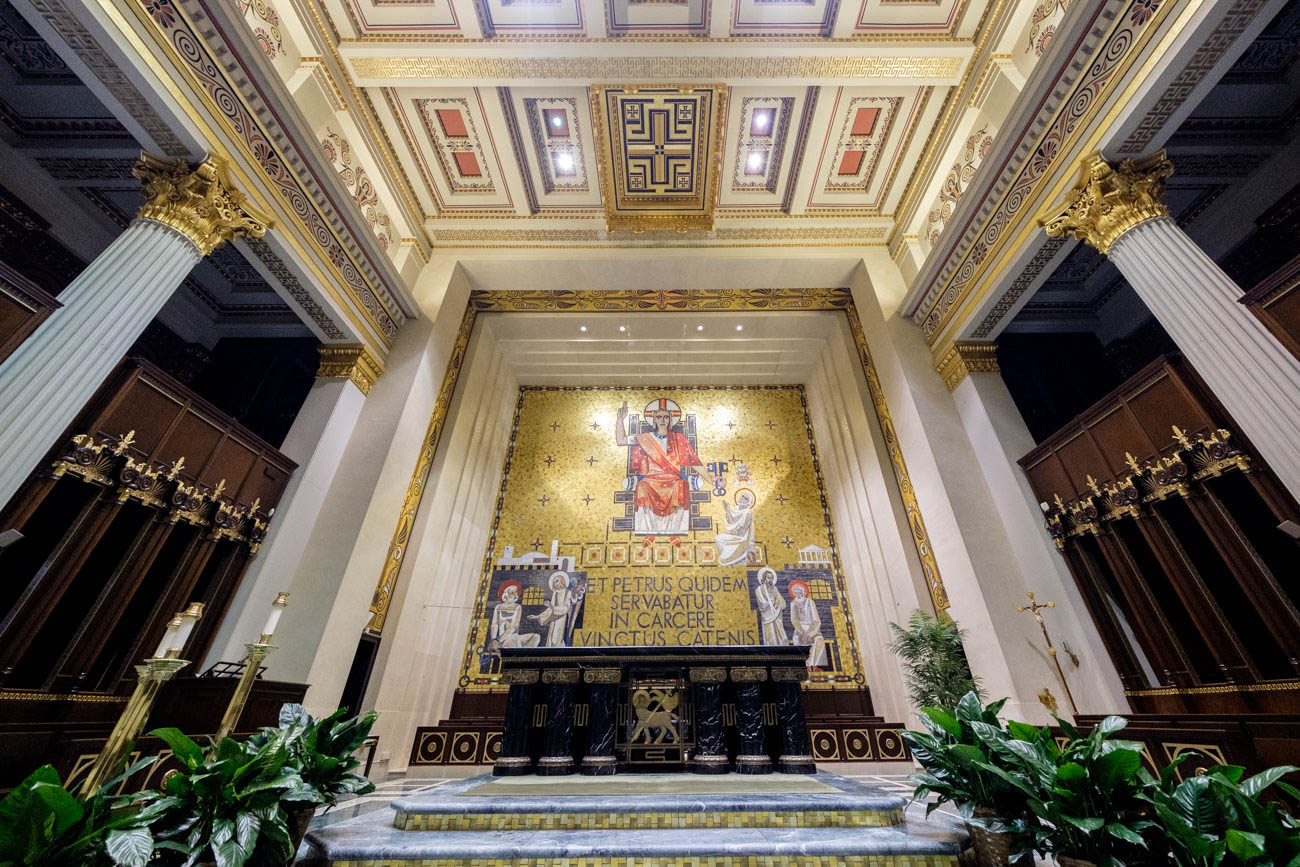 The gold mosaic in the rear of the church is made of Venetian glass. The work of art sports thousands of stone and glass pieces that were placed together backwards on linen before being installed in mortar along a masonry setting. The cathedral claims the Venetian glass mosaic is the largest work of its kind in the United States. / Image: Daniel Smyth // Published: 7.3.19
