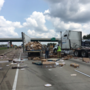 Frozen pizzas scattered near I-30 overpass in tractor-trailer accident