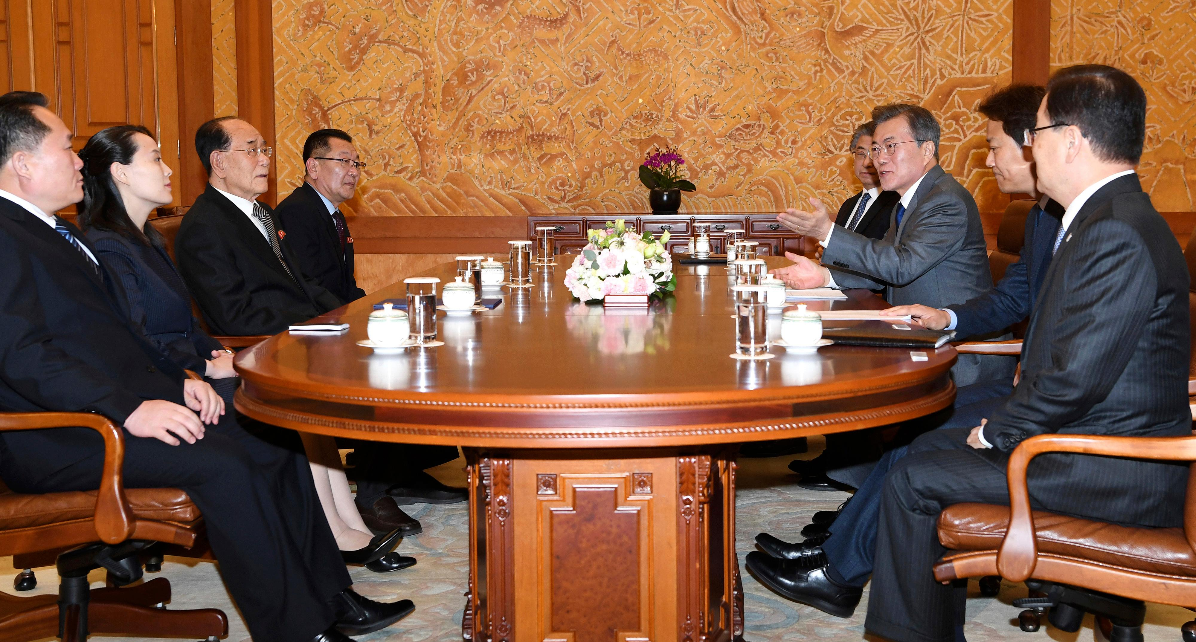 South Korean President Moon Jae-in, third from right, speaks to Kim Yo Jong, second from left, sister of North Korean leader Kim Jong Un, and North Korean delegation during a meeting at the presidential house in Seoul, South Korea, Saturday, Feb. 10, 2018. President Moon on Saturday met with the senior North Korean officials over lunch at Seoul's presidential palace in the most significant diplomatic encounter between the rivals in years. (Kim Ju-sung/Yonhap via AP)