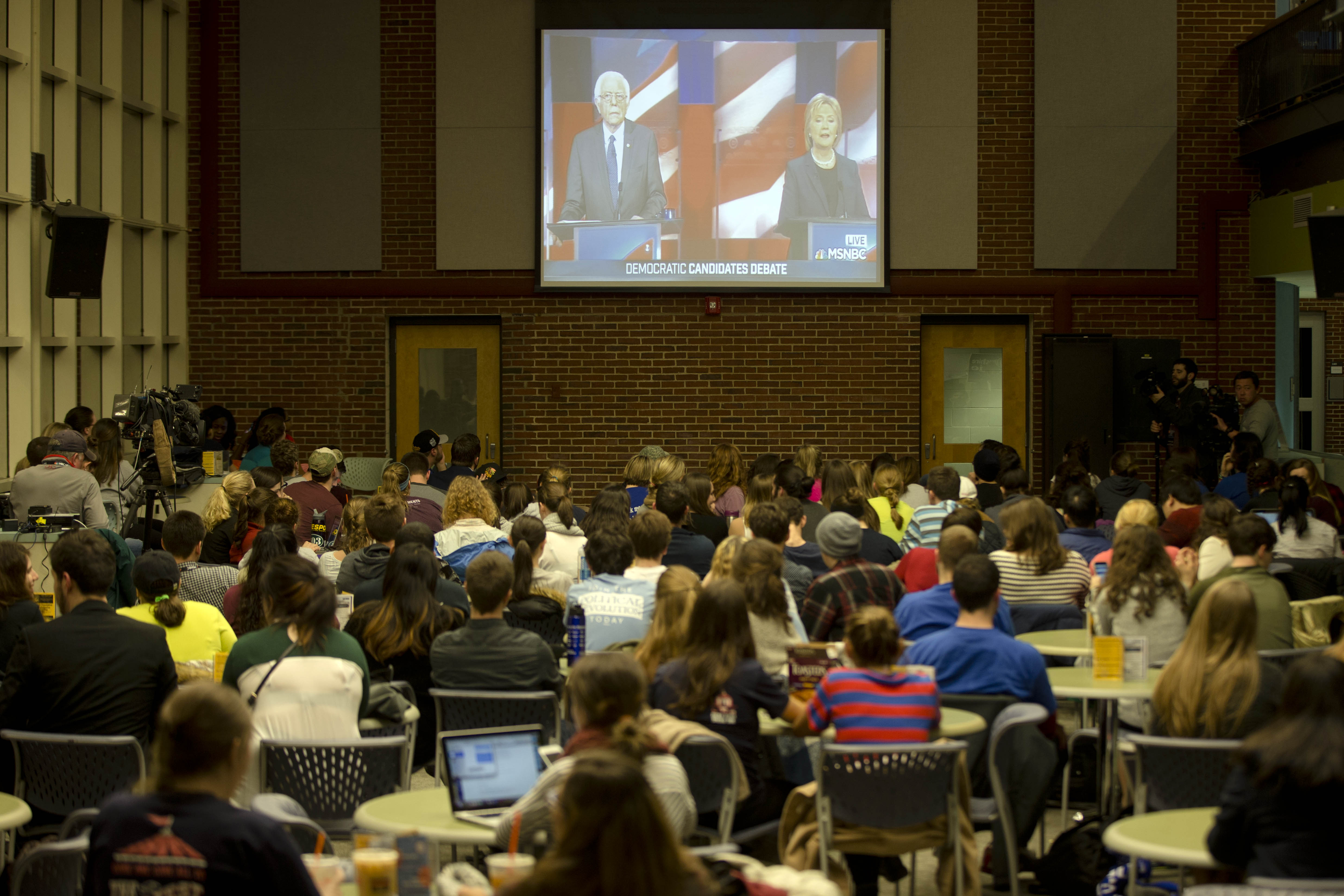 Students view on a video screen the Democratic presidential debate between candidates Sen. Bernie Sanders, I-Vt, Thursday, Feb. 4, 2016, at University of New Hampshire in Durham, N.H. (AP Photo/Matt Rourke)