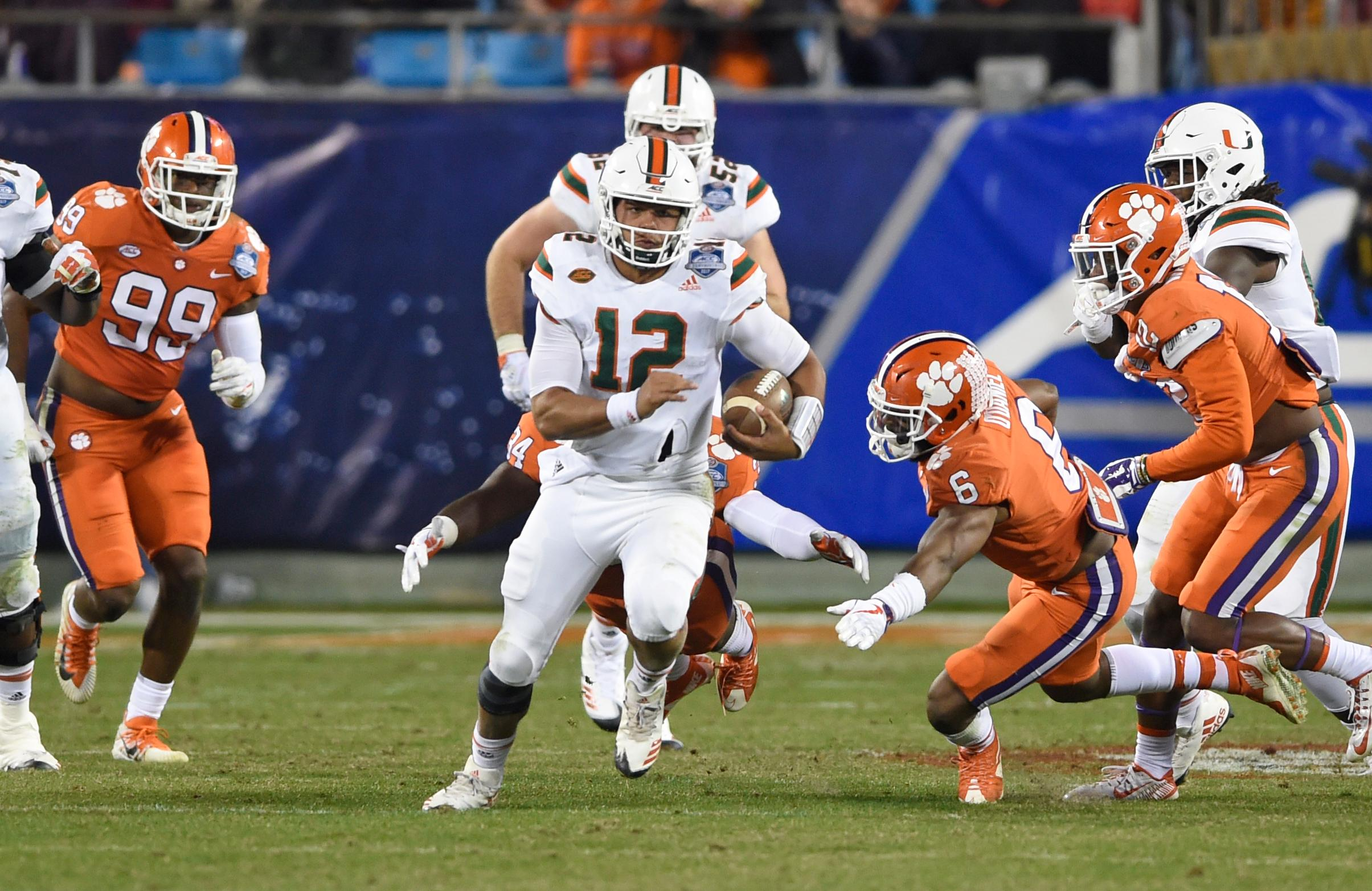Miami's Malik Rosier (12) runs for a long gain against Clemson during the second half of the Atlantic Coast Conference championship NCAA college football game in Charlotte, N.C., Saturday, Dec. 2, 2017. (AP Photo/Mike McCarn)