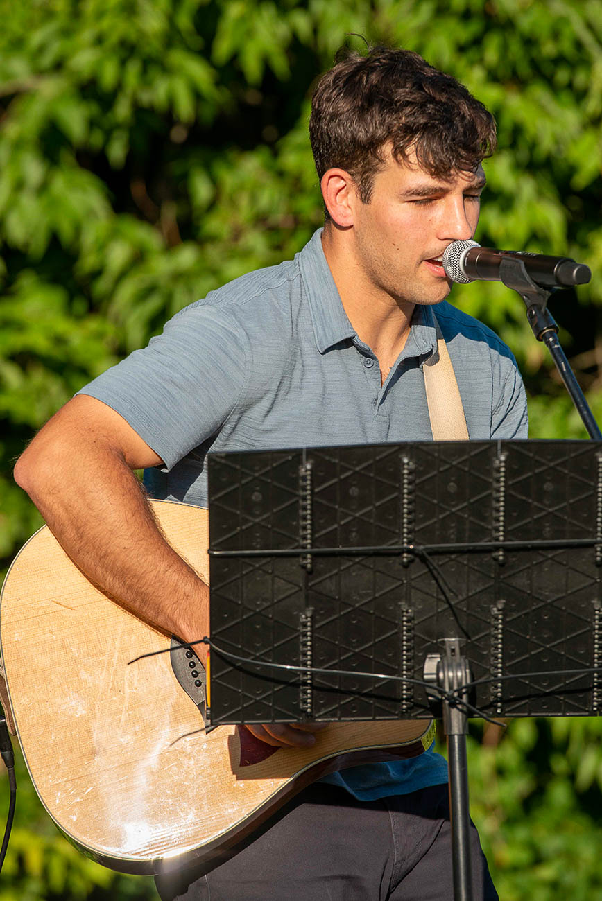 Local artist Johnny Walylko played some acoustic music.{ }/ Image: Joe Simon // Published: 7.14.19