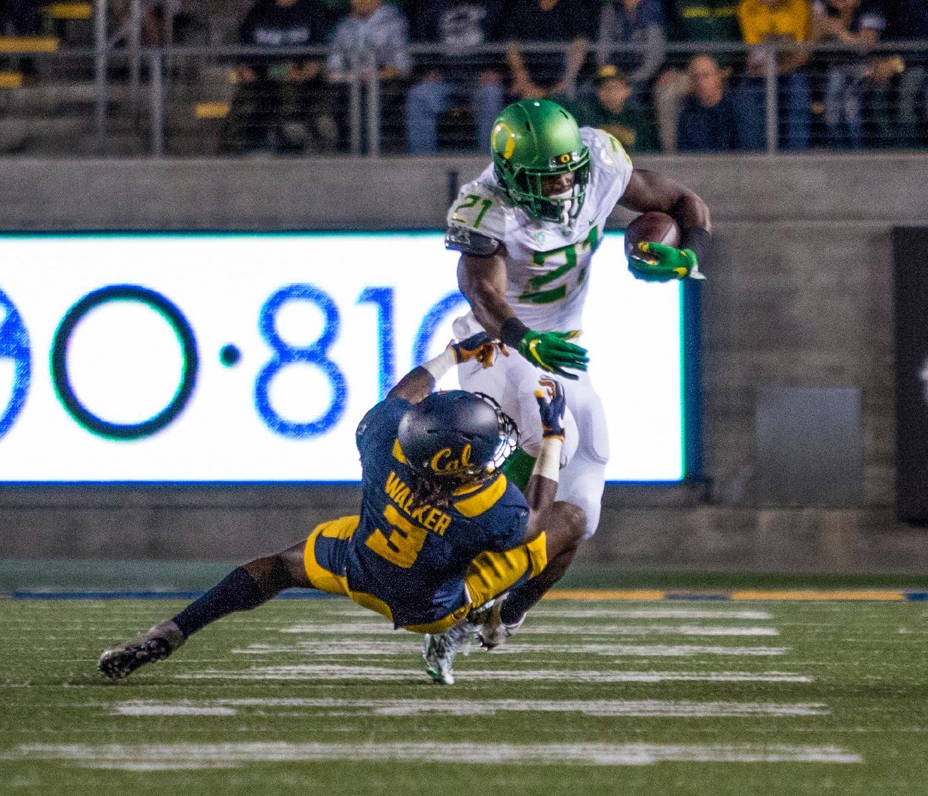 California Bears Cameron Walker (#3) attempts to tackle Oregon Ducks Royce Freeman (#21). The California Bears beat the Oregon Ducks 52-49 in 2 OT at California Memorial Stadium in Berkeley, CA on Friday evening. Photo by Katie Pietzold
