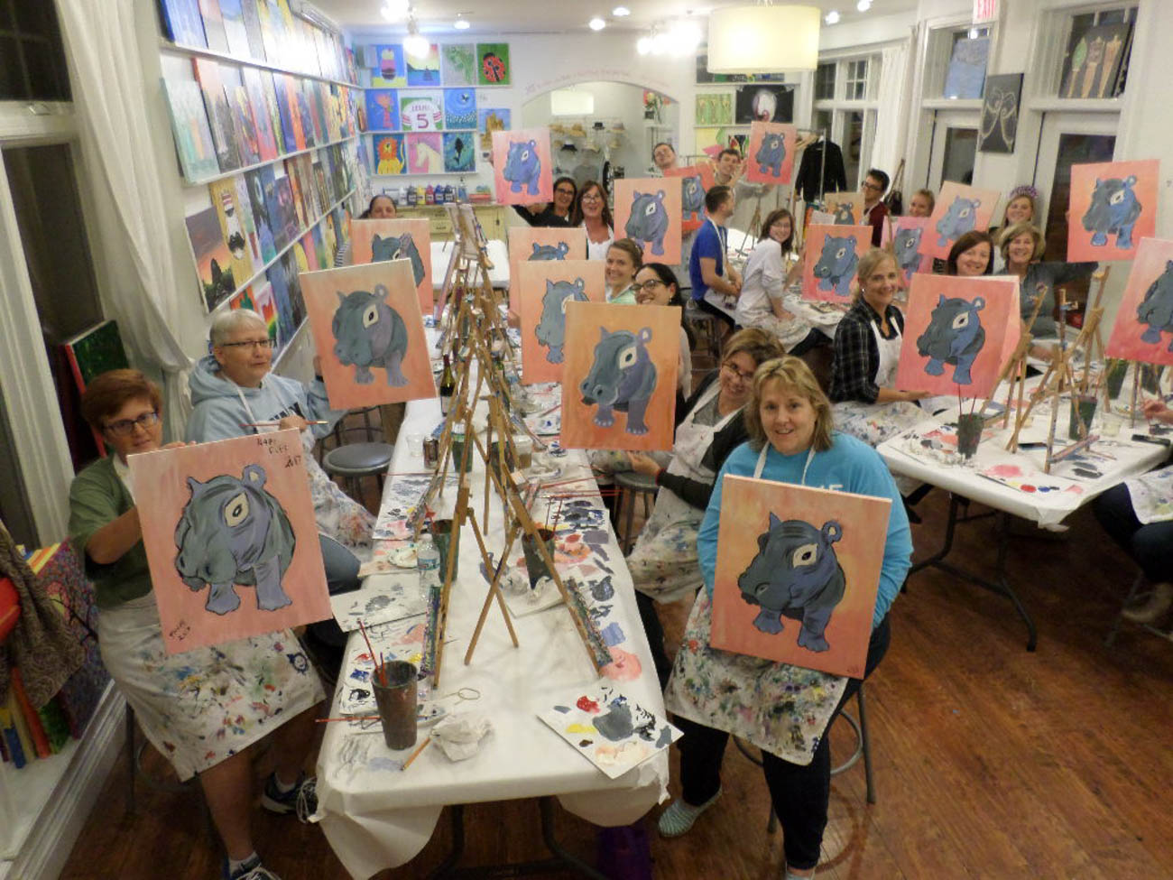 "PLACE: Cheers to Art! / ADDRESS: 7700 Camargo Road (45243) / This locally-owned art facility jazzes up the art scene with live music once a month on WAM Nights (wine, art, and music). Classes include painting on a canvas, or, as they like to call, making a ""wood creation,"" which is where you paint on a wooden sign or decor piece. The bar in their Madeira studio features wine, beer, and soft drinks. They also host art events at other local sites, such as at Paul Brown Stadium, U.C., businesses, or even in your own home. All of the paintings are designed by the staff. / Image courtesy of Cheers to Art! // Published: 12.21.18"