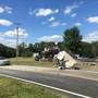 Driver transported to hospital after cement truck overturns